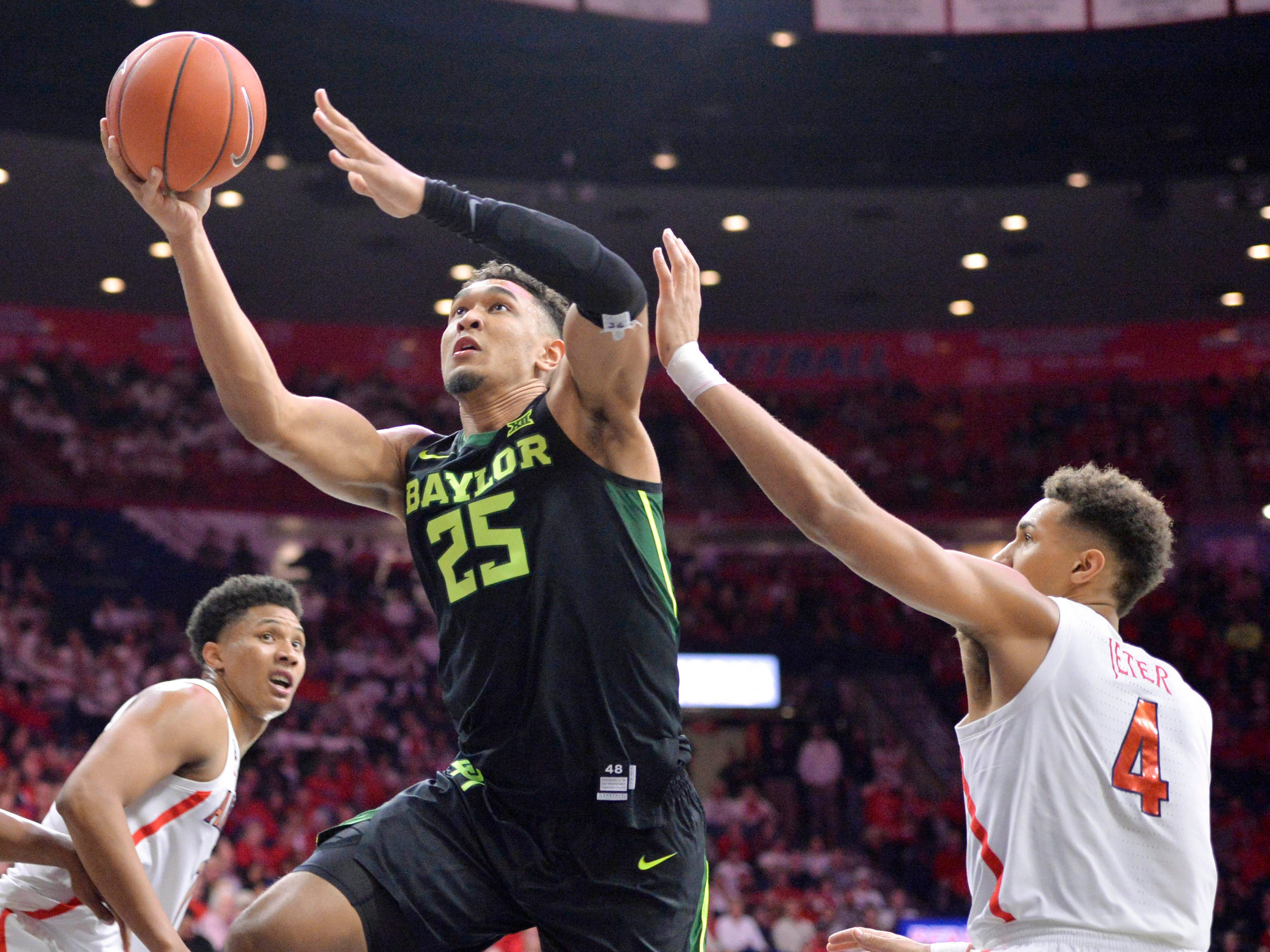 Dec 15, 2018; Tucson, AZ, USA; Baylor Bears forward Tristan Clark (25) shoots the ball as Arizona Wildcats center Chase Jeter (4) defends during the first half at McKale Center.