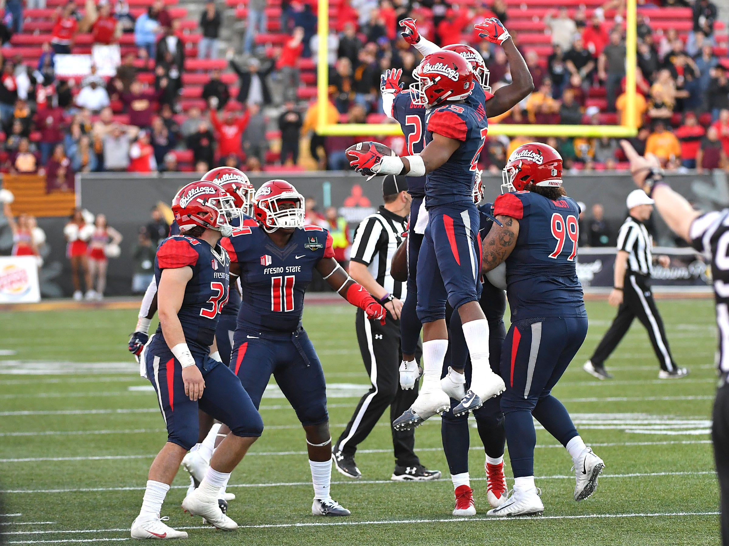 Dec 15, 2018; Las Vegas, NV, United States; Fresno State Bulldogs defensive back Juju Hughes (23) celebrates with team mates after making a second half interception against the Arizona State Sun Devils at Sam Boyd Stadium.