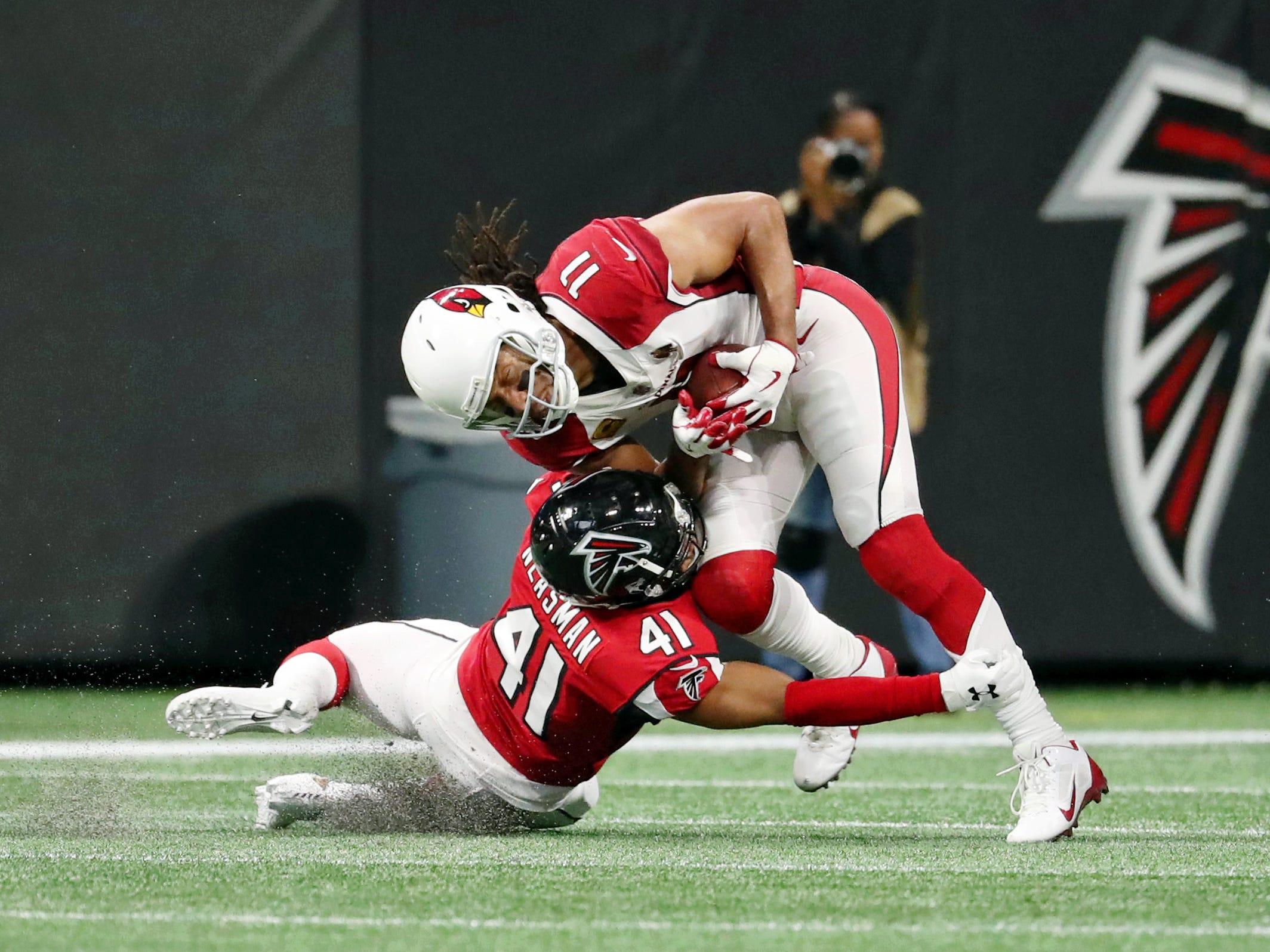 Dec 16, 2018; Atlanta, GA, USA; Arizona Cardinals wide receiver Larry Fitzgerald (11) is tackled by Atlanta Falcons defensive back Sharrod Neasman (41) in the second quarter at Mercedes-Benz Stadium.