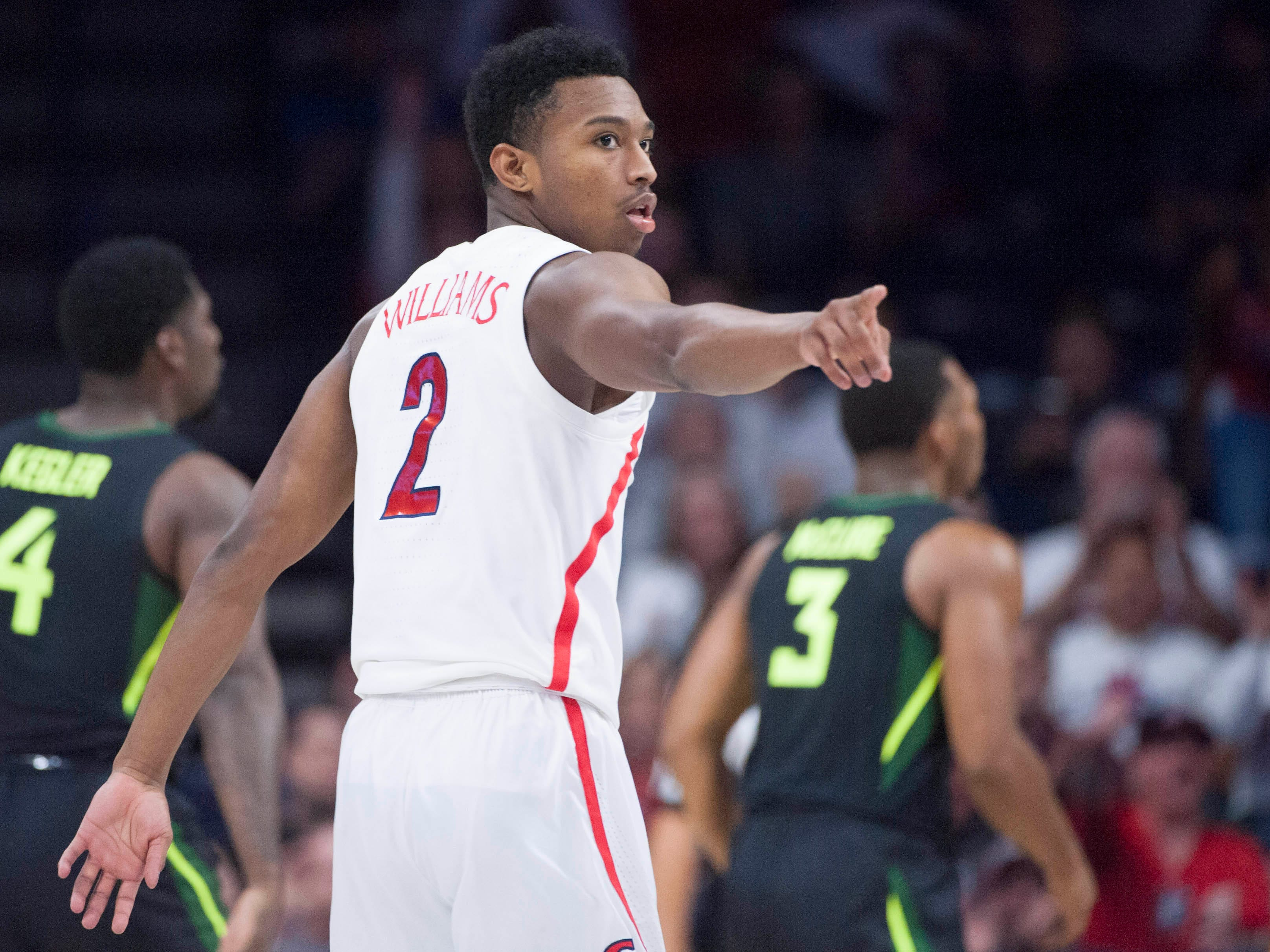 Dec 15, 2018; Tucson, AZ, USA; Arizona Wildcats guard Brandon Williams (2) points to the bench after scoring against the Baylor Bears during the first half at McKale Center.