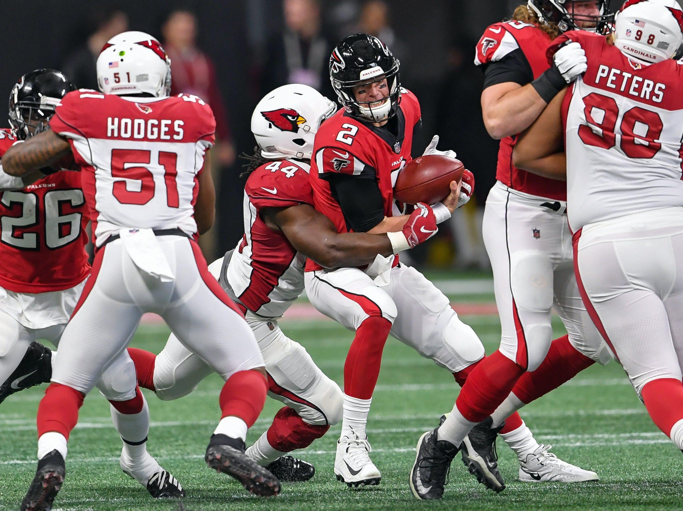 Dec 16, 2018; Atlanta, GA, USA; Atlanta Falcons quarterback Matt Ryan (2) is sacked by Arizona Cardinals defensive end Markus Golden (44) during the first quarter at Mercedes-Benz Stadium.
