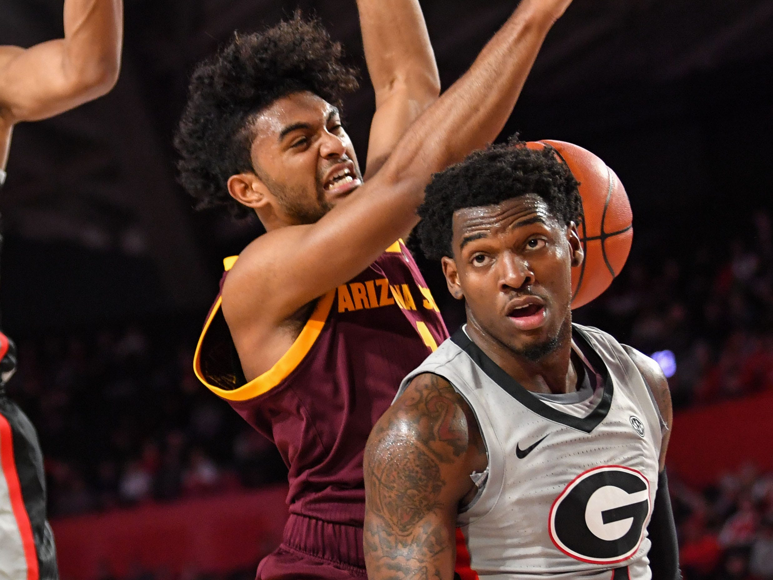 Dec 15, 2018; Athens, GA, USA; Arizona State Sun Devils guard Remy Martin (1) loses the ball to the defense of Georgia Bulldogs guard Tyree Crump (4) during the first half at Stegeman Coliseum.