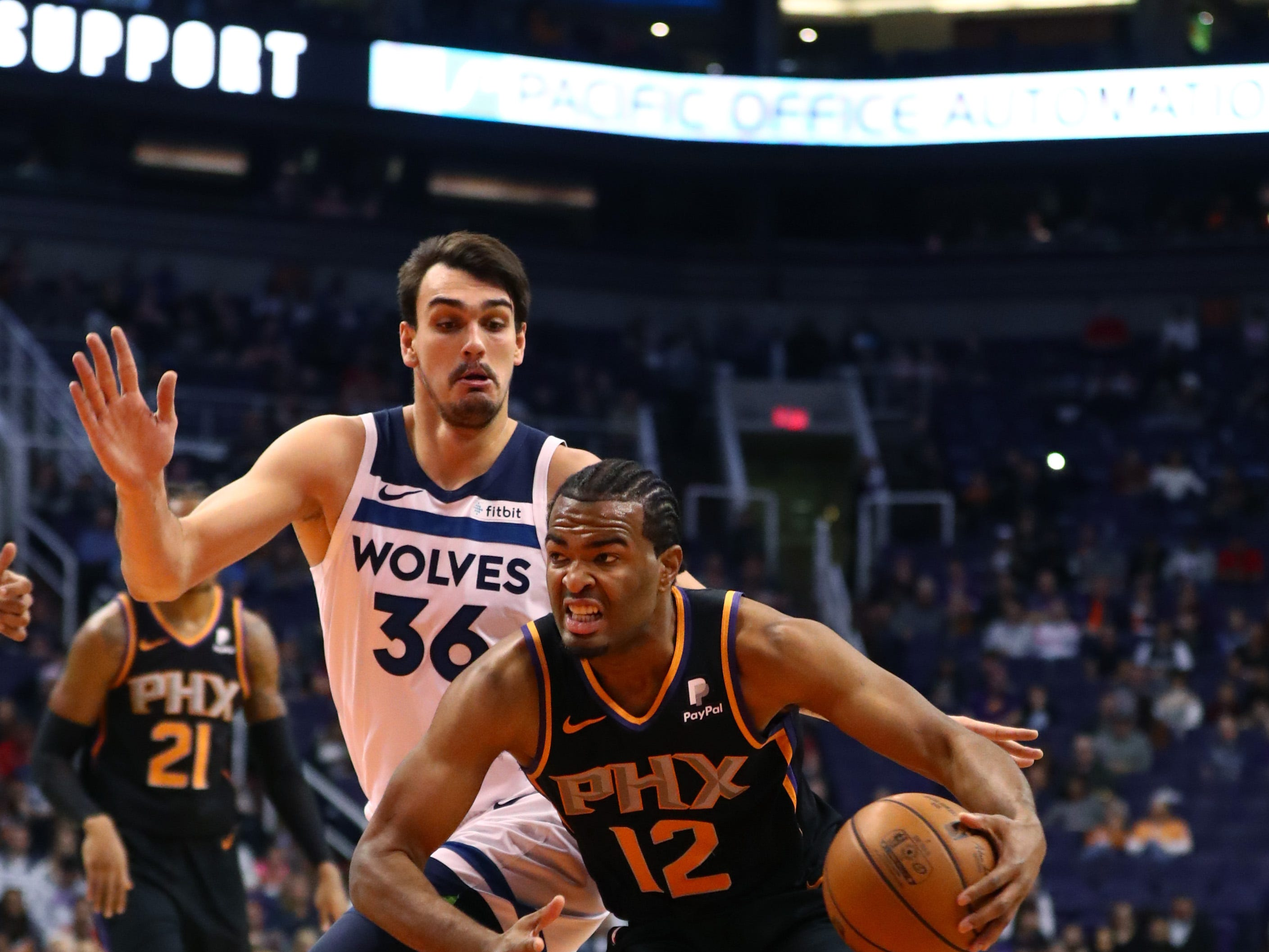 Dec 15, 2018; Phoenix, AZ, USA; Phoenix Suns forward TJ Warren (12) drives to the basket against Minnesota Timberwolves forward Dario Saric (36) in the first half at Talking Stick Resort Arena. Mandatory Credit: Mark J. Rebilas-USA TODAY Sports