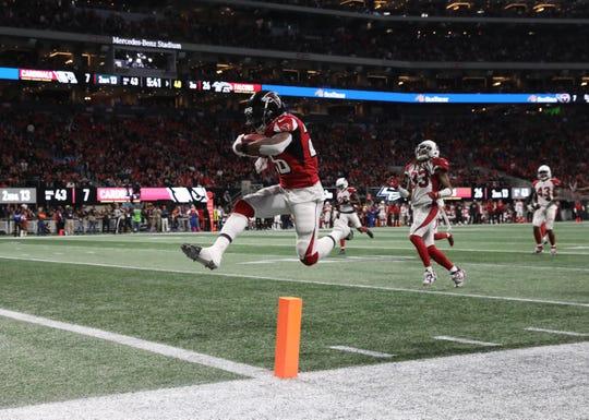 Dec 16, 2018; Atlanta, GA, USA; Atlanta Falcons running back Tevin Coleman (26) scores a rushing touchdown in the third quarter against the Arizona Cardinals at Mercedes-Benz Stadium.