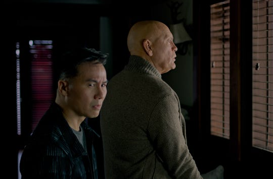 "Greg (BD Wong, left) and Douglas must avoid looking outside in ""Bird Box."""