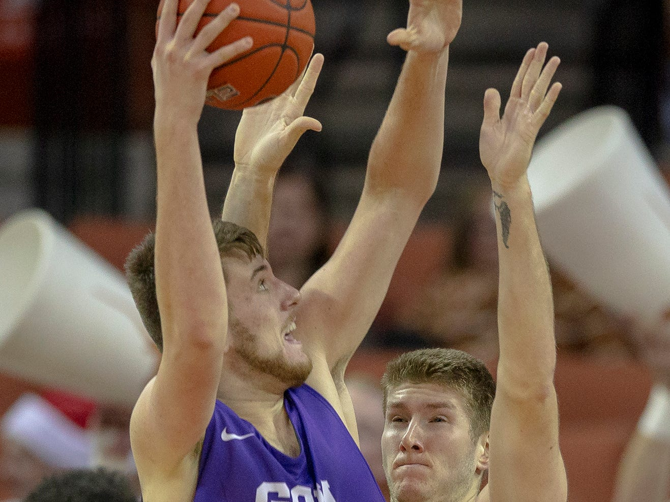 Grand Canyon center Alessandro Lever (25) shoots over Texas forward Dylan Osetkowski (21) during an NCAA college basketball game on Saturday, Dec. 15, 2018, in Austin, Texas.