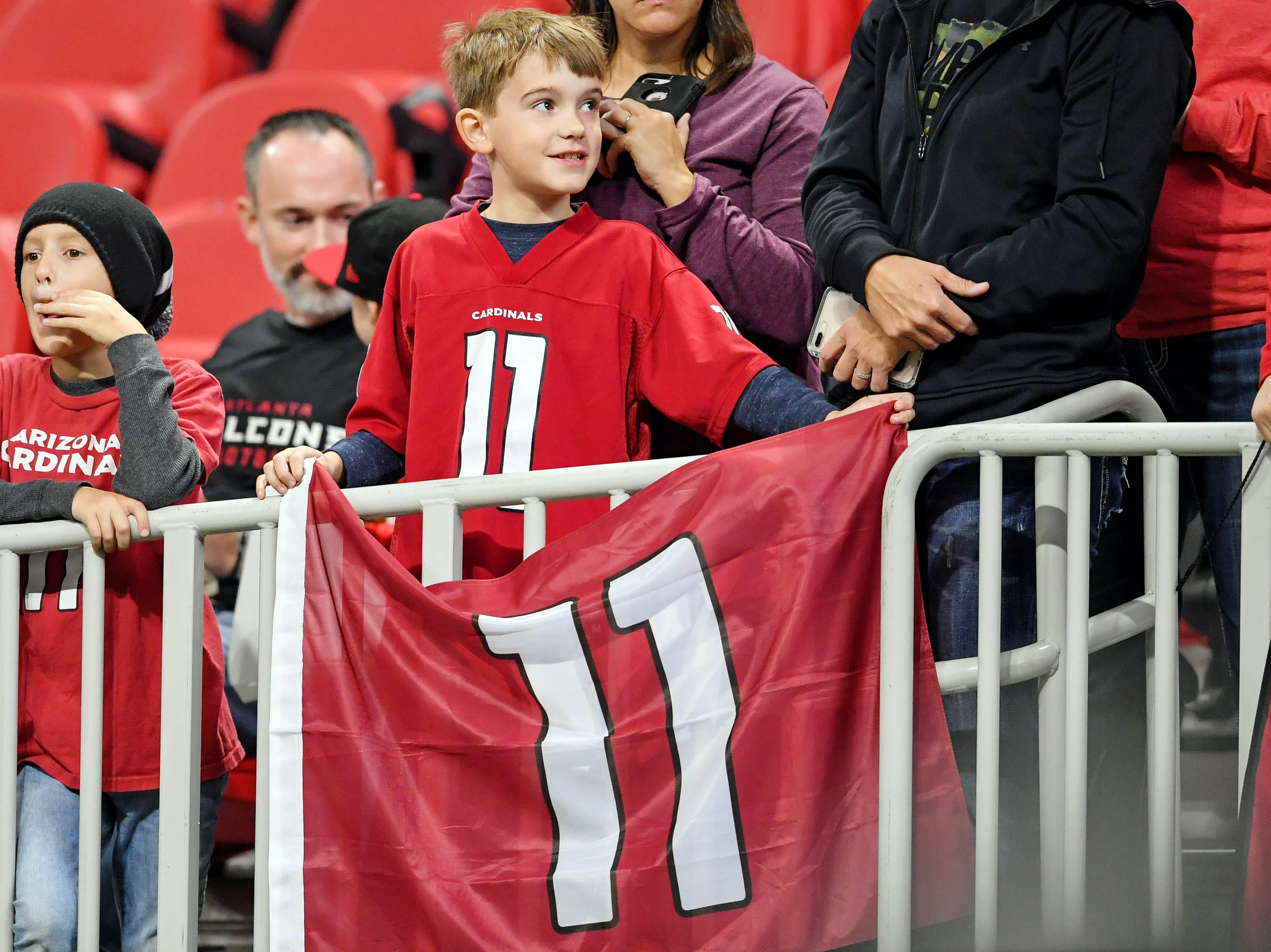 Dec 16, 2018; Atlanta, GA, USA; A fan of the Arizona Cardinals looks for his favorite players during pregame prior to the game against the Atlanta Falcons at Mercedes-Benz Stadium.