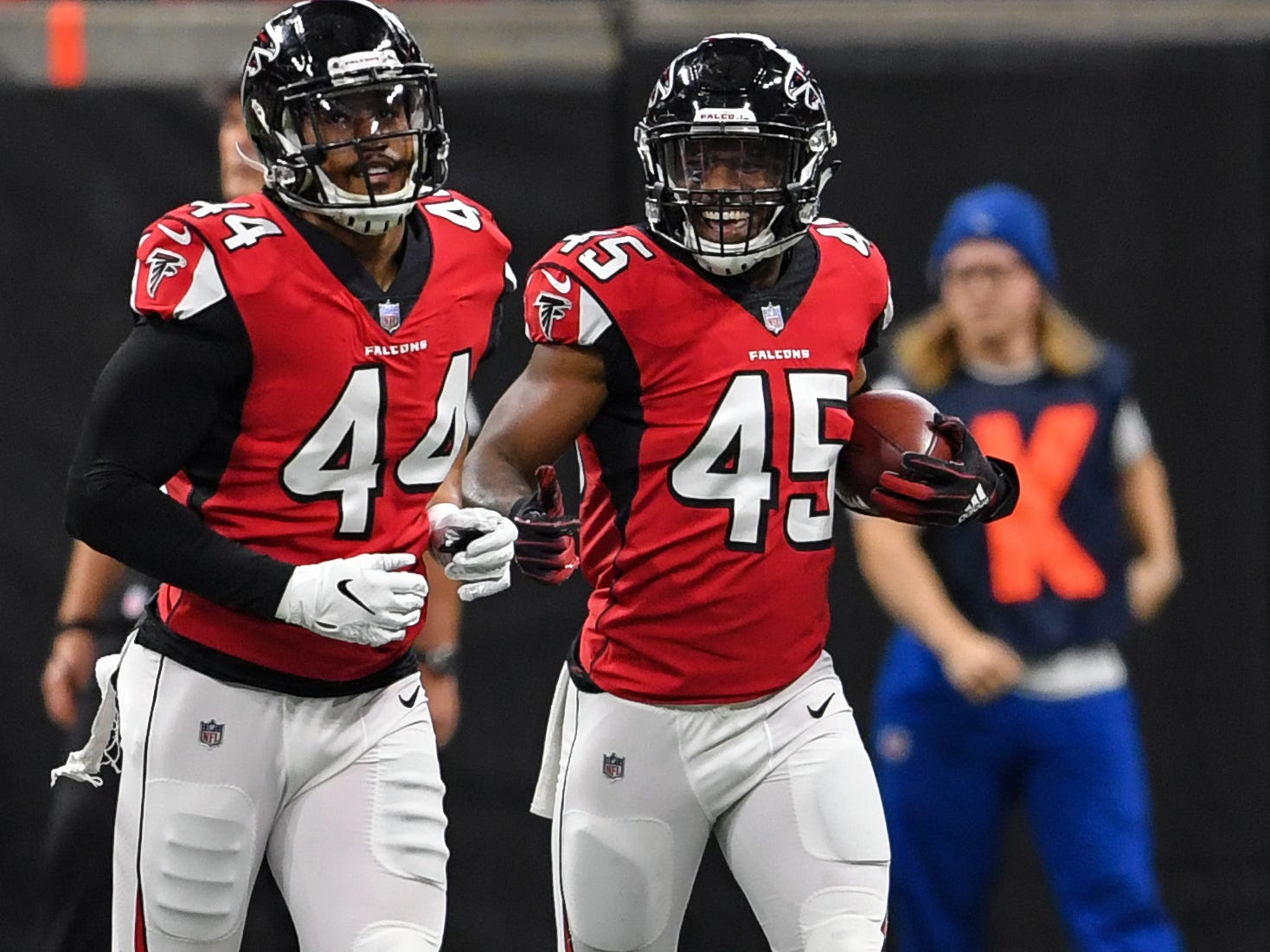 Dec 16, 2018; Atlanta, GA, USA; Atlanta Falcons linebacker Deion Jones (45) reacts after returning an interception for a touchdown against the Arizona Cardinals during the first quarter at Mercedes-Benz Stadium.