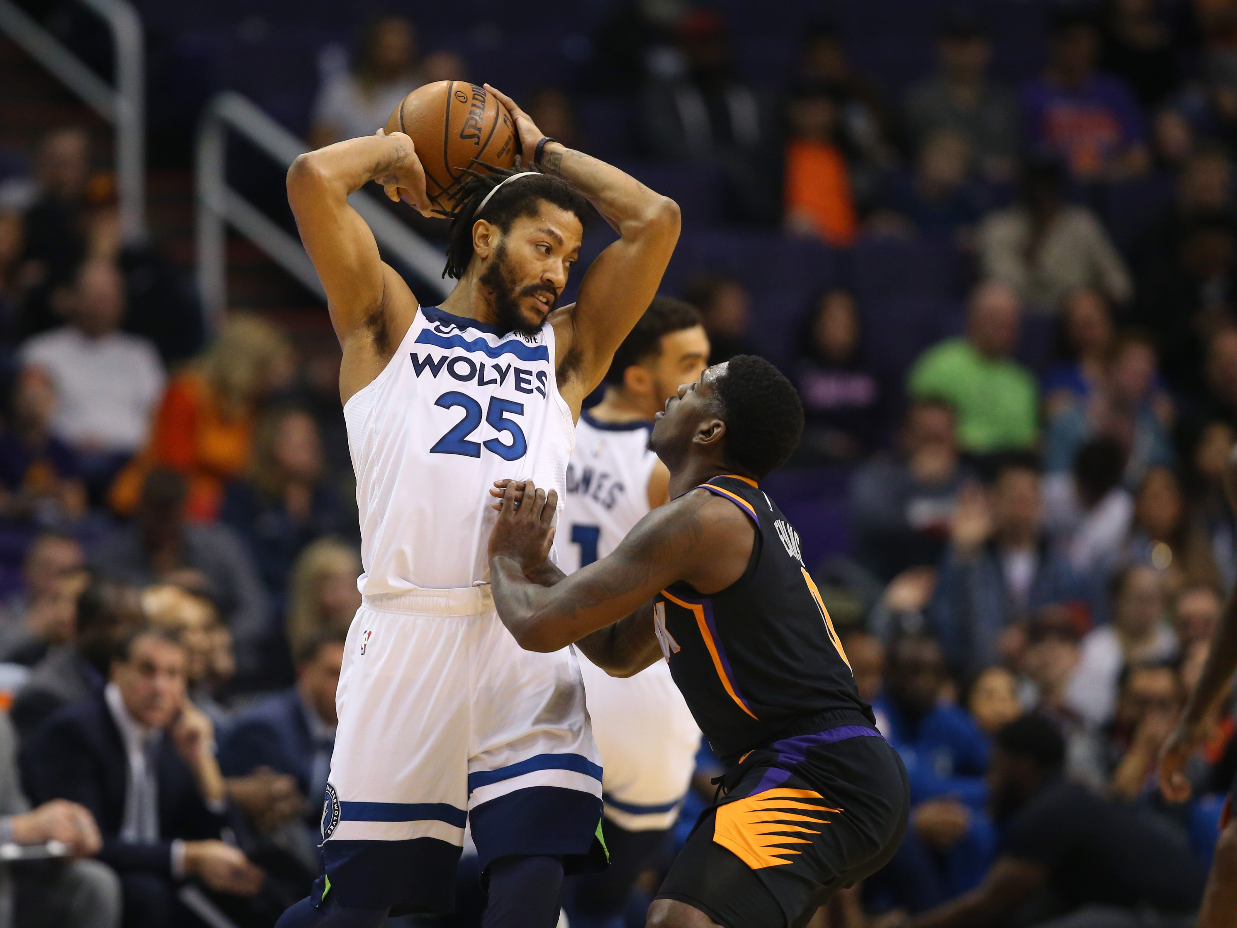 Dec 15, 2018; Phoenix, AZ, USA; Minnesota Timberwolves guard Derrick Rose (25) against Phoenix Suns guard Jawun Evans in the first half at Talking Stick Resort Arena. Mandatory Credit: Mark J. Rebilas-USA TODAY Sports
