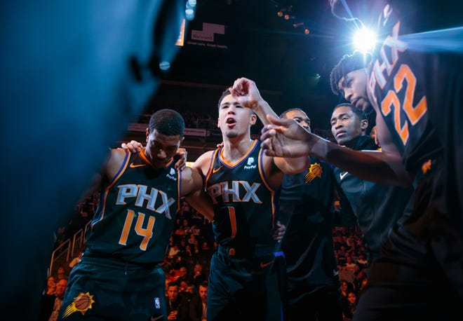 """""""I'm just having fun playing with high energy, crowds involved, fans are involved, playing good basketball,"""" Devin Booker said of the Suns streak."""