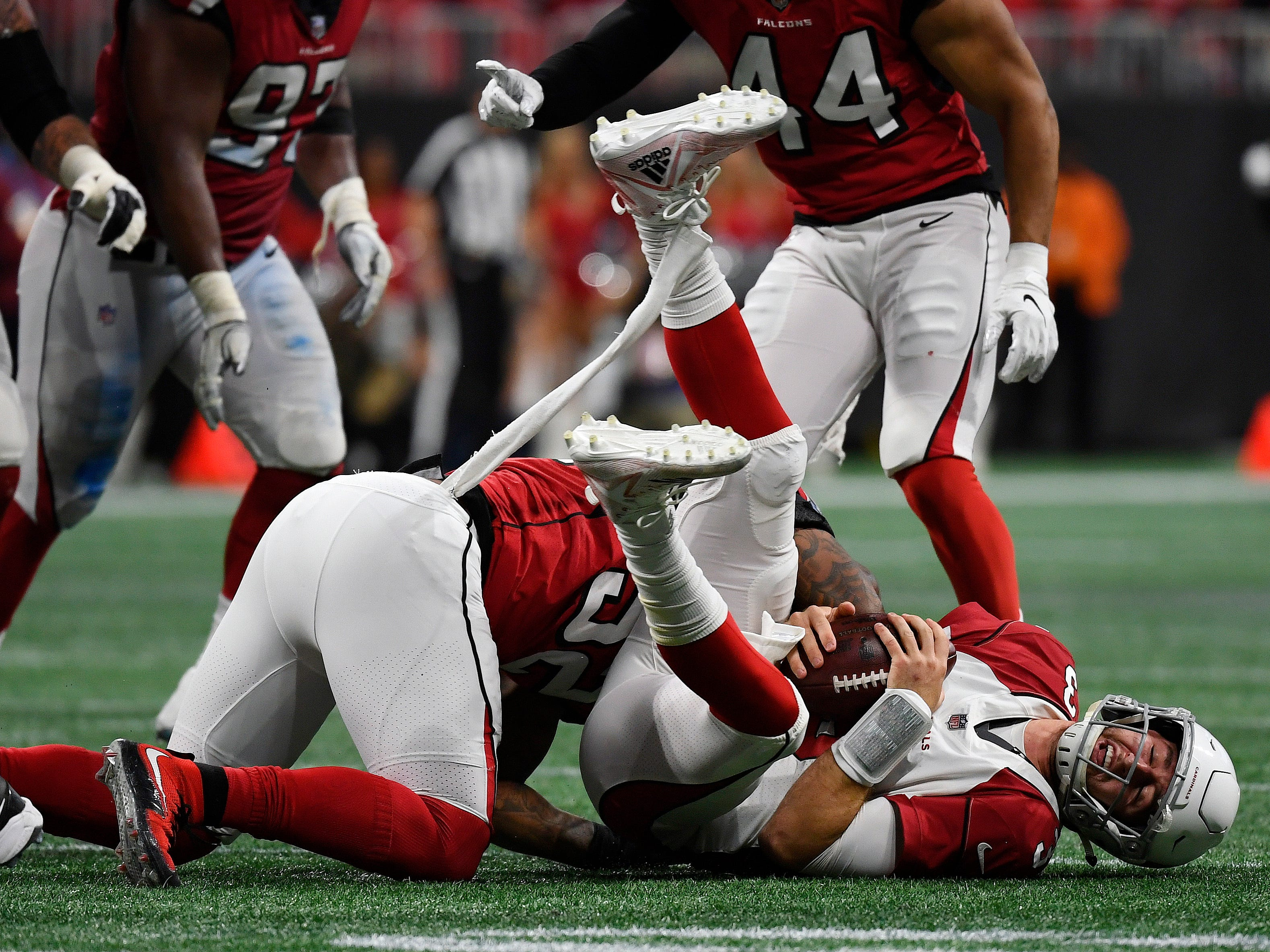 Arizona Cardinals quarterback Josh Rosen (3) is sacked by Atlanta Falcons defensive end Bruce Irvin (52) during the second half of an NFL football game, Sunday, Dec. 16, 2018, in Atlanta.