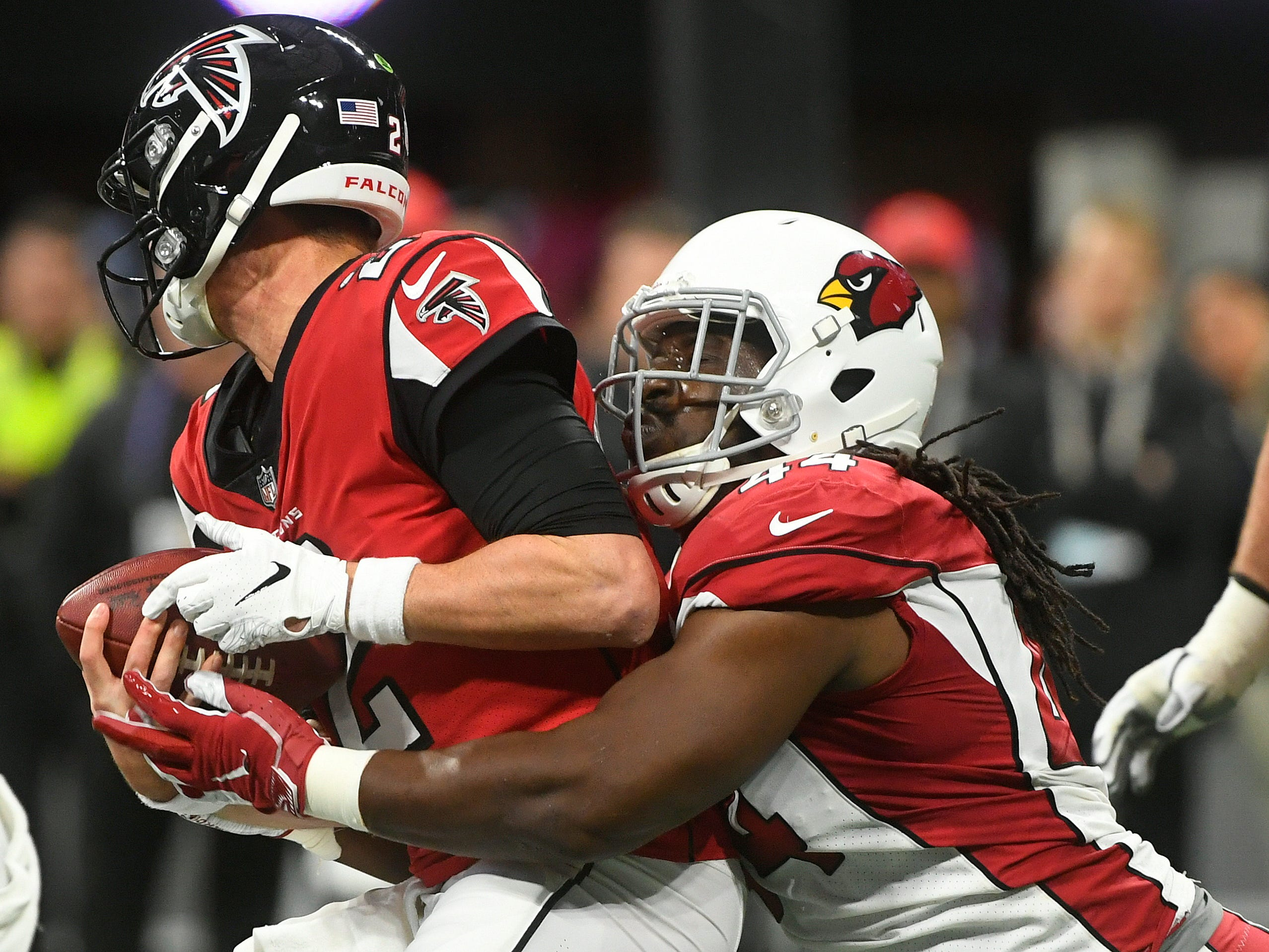 Arizona Cardinals defensive end Markus Golden (44) sacks Atlanta Falcons quarterback Matt Ryan (2) during the first half of an NFL football game, Sunday, Dec. 16, 2018, in Atlanta.