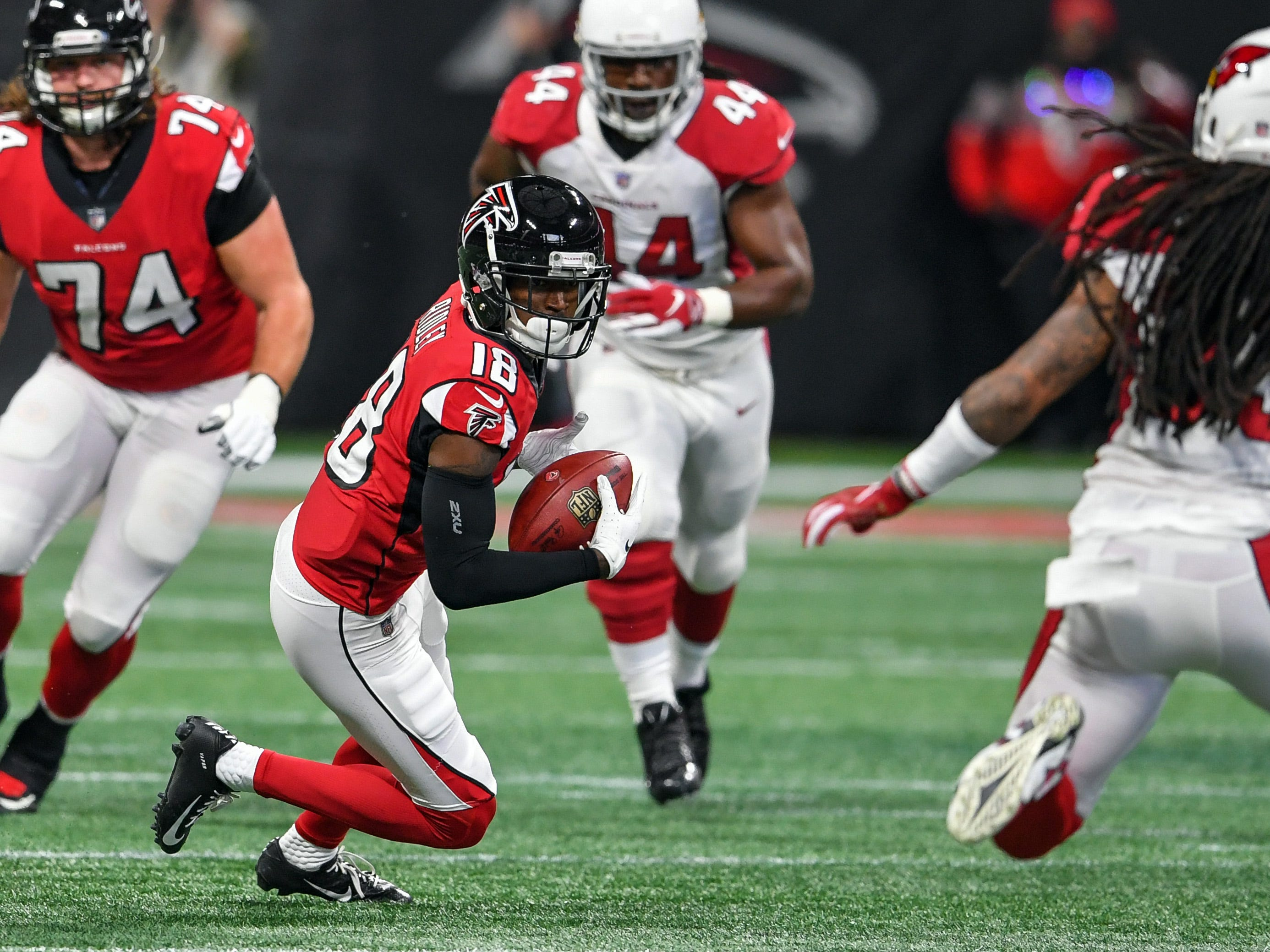 Dec 16, 2018; Atlanta, GA, USA; Atlanta Falcons wide receiver Calvin Ridley (18) runs after a catch against the Arizona Cardinals during the first quarter at Mercedes-Benz Stadium.