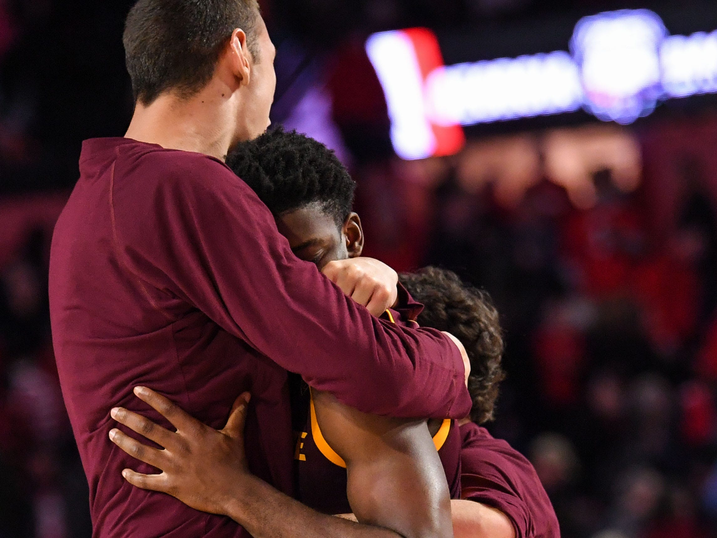 Dec 15, 2018; Athens, GA, USA; Arizona State Sun Devils guard Luguentz Dort (0) (center) is hugged by teammates after the Sun Devils defeated the Georgia Bulldogs  at Stegeman Coliseum.