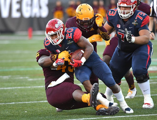 Fresno State Bulldogs running back Ronnie Rivers (20) completes a second half run against the Arizona State Sun Devils at Sam Boyd Stadium.
