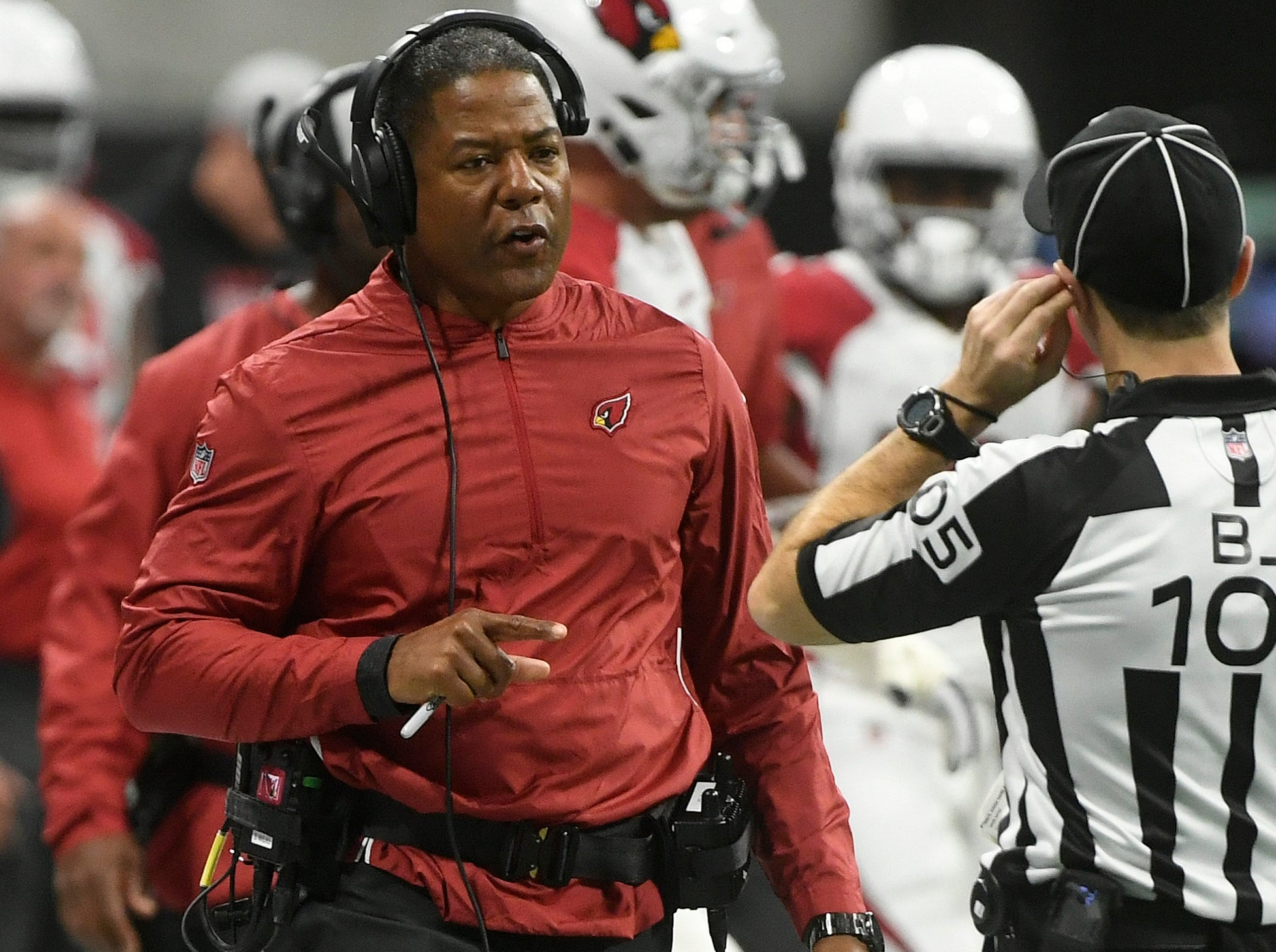 Arizona Cardinals head coach Steve Wilks speaks to field judge Rick Patterson (15) during the first half of an NFL football game between the Atlanta Falcons and the Arizona Cardinals, Sunday, Dec. 16, 2018, in Atlanta.
