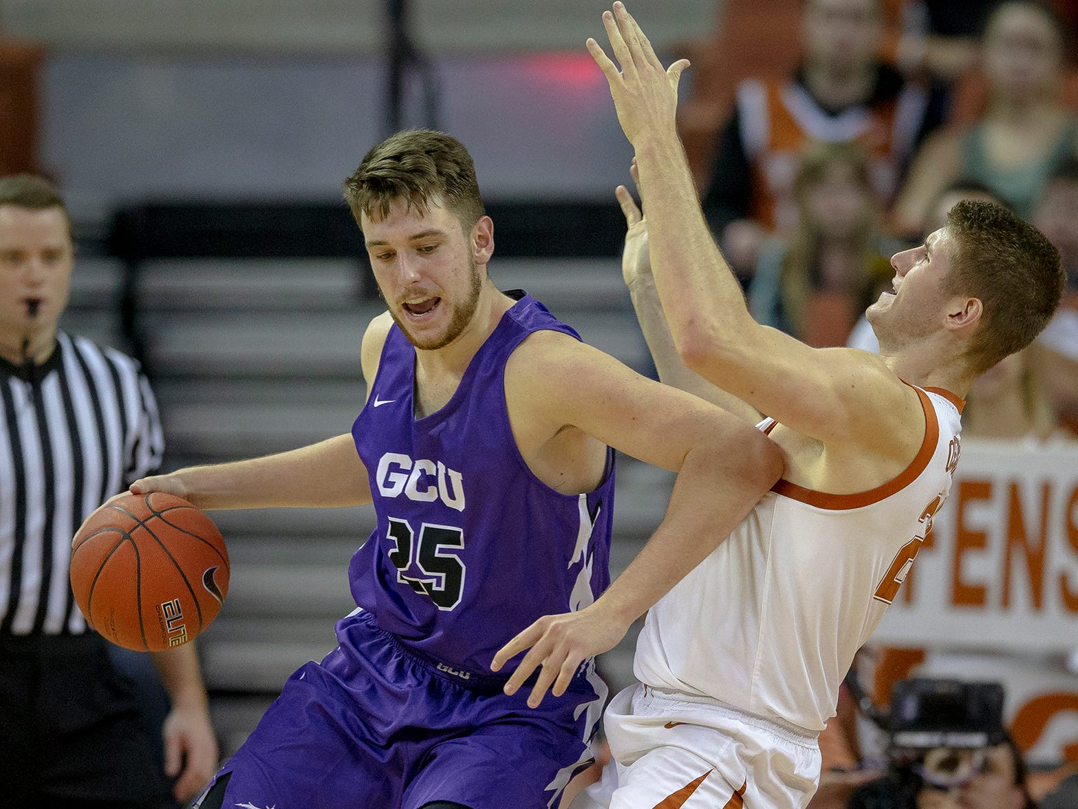 Grand Canyon center Alessandro Lever (25) backs into Texas forward Dylan Osetkowski (21) during an NCAA college basketball game on Saturday, Dec. 15, 2018, in Austin, Texas.