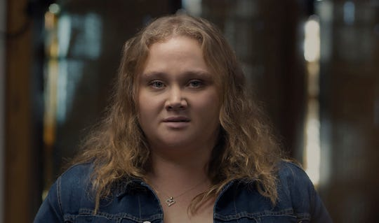 "Olympia (Danielle Macdonald) finds herself living with others who have survived an apocalyptic event in ""Bird Box."""