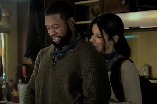 "In ""Bird Box,"" a relationship develops between Tom (Trevante Rhodes) and Malorie (Sandra Bullock)."