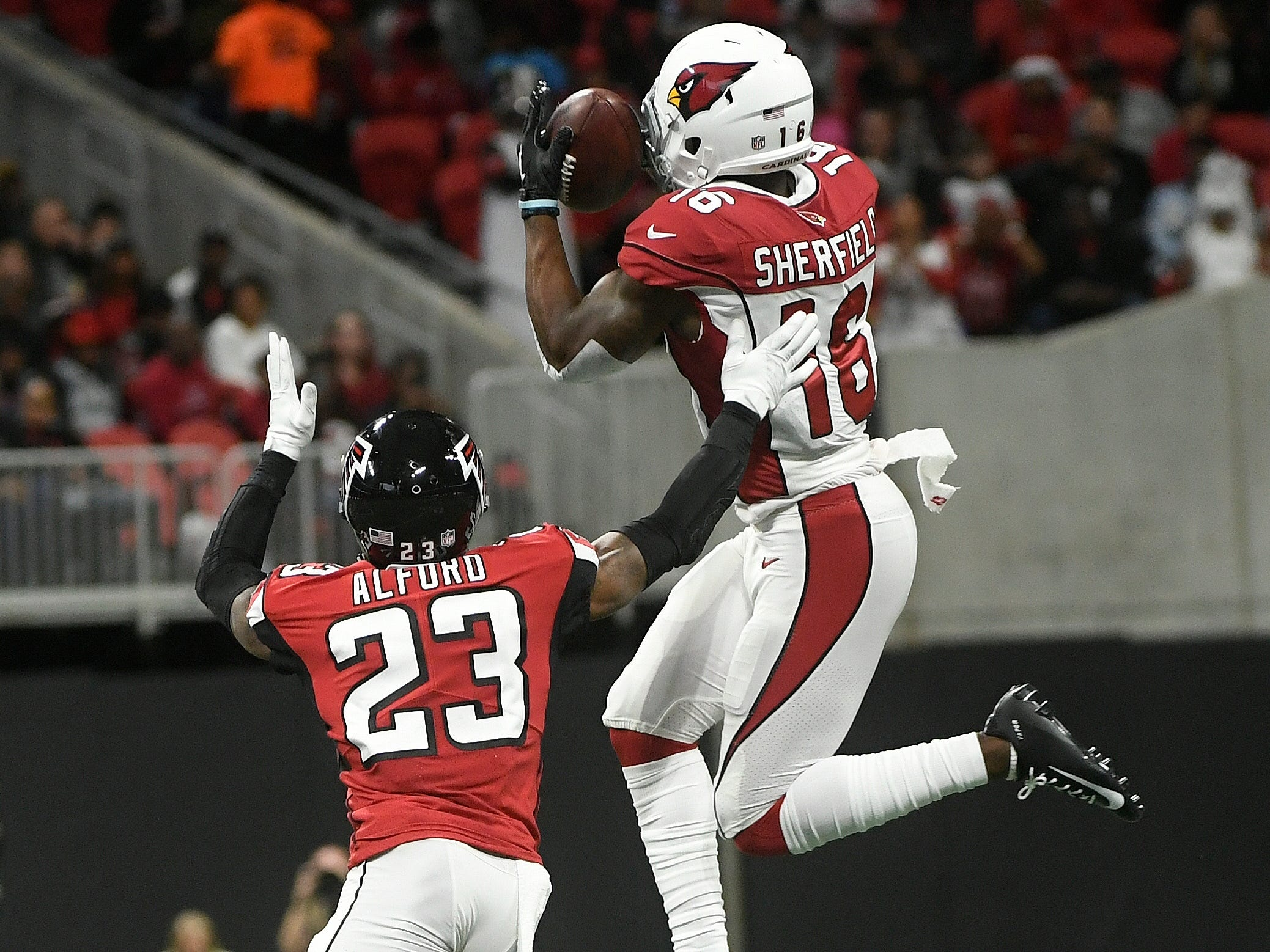 Arizona Cardinals wide receiver Trent Sherfield (16) makes the catch against Atlanta Falcons cornerback Robert Alford (23) during the first half of an NFL football game, Sunday, Dec. 16, 2018, in Atlanta.