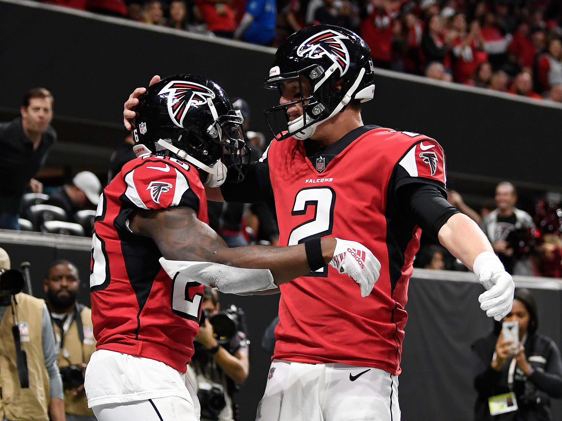 Atlanta Falcons running back Tevin Coleman (26) celebrates with quarterback Matt Ryan after scoring a touchdown during the second half of an NFL football game against the Arizona Cardinals , Sunday, Dec. 16, 2018, in Atlanta.