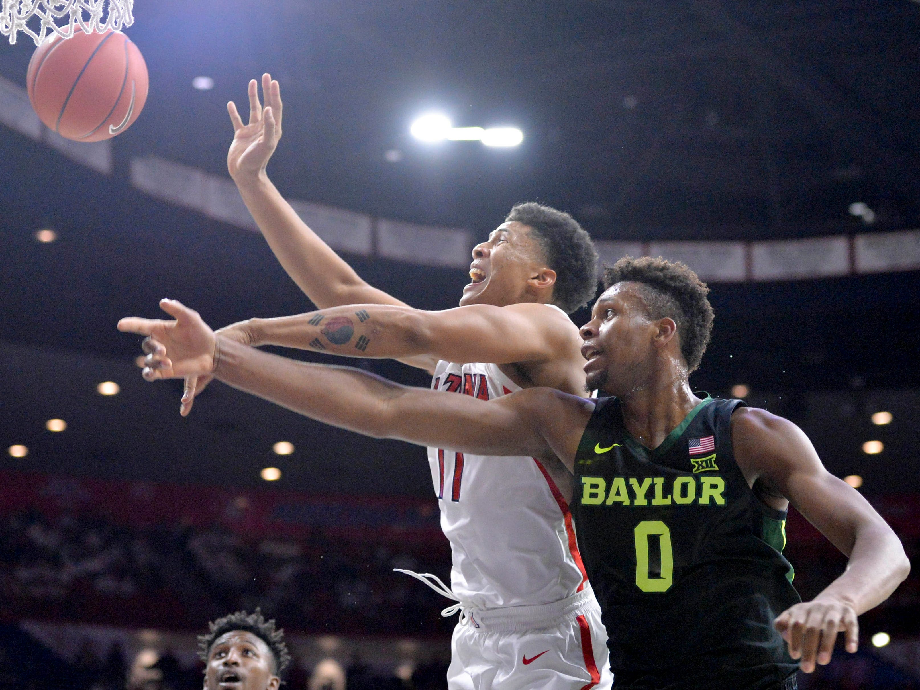 Dec 15, 2018; Tucson, AZ, USA; Arizona Wildcats forward Ira Lee (11) and Baylor Bears forward Flo Thamba (0) battle for the ball during the first half at McKale Center.