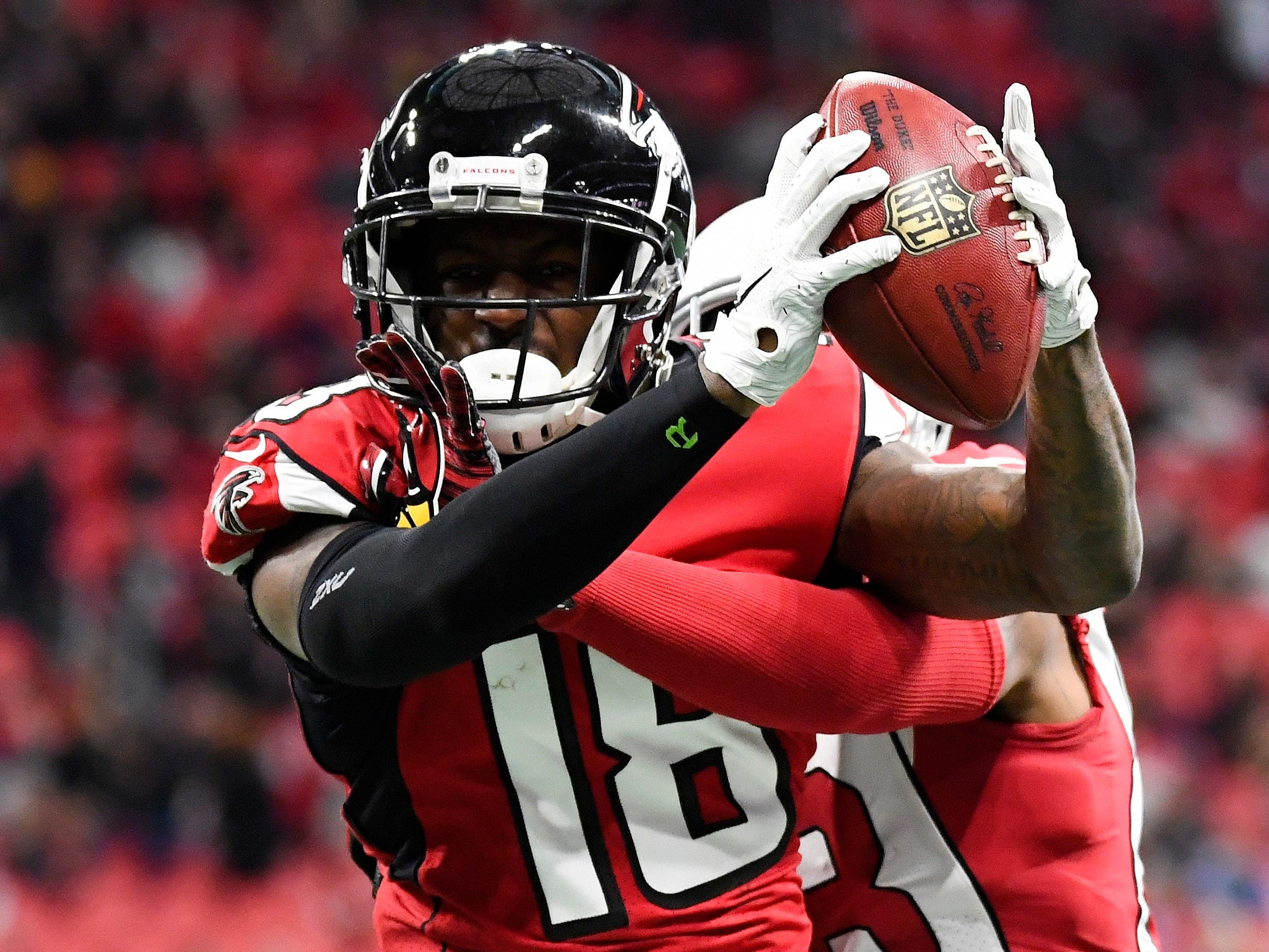 Atlanta Falcons wide receiver Calvin Ridley (18) makes a catch as Arizona Cardinals defensive back David Amerson (38) defends in the first half of an NFL football game against the Arizona Cardinals, Sunday, Dec. 16, 2018, in Atlanta.