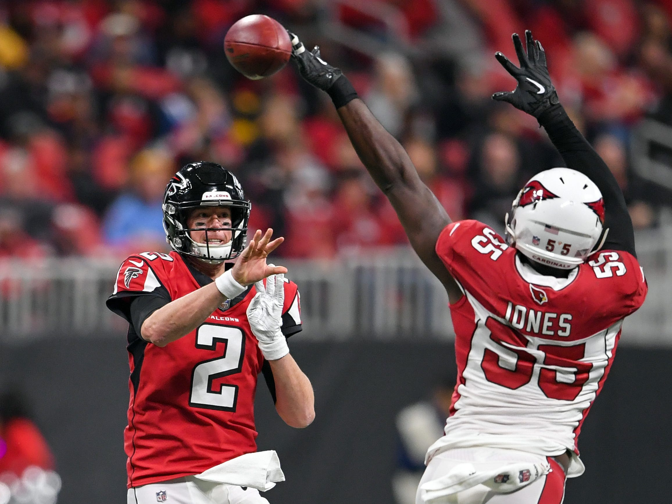 Dec 16, 2018; Atlanta, GA, USA; Atlanta Falcons quarterback Matt Ryan (2) passes the ball past Arizona Cardinals defensive end Chandler Jones (55) during the first half at Mercedes-Benz Stadium.