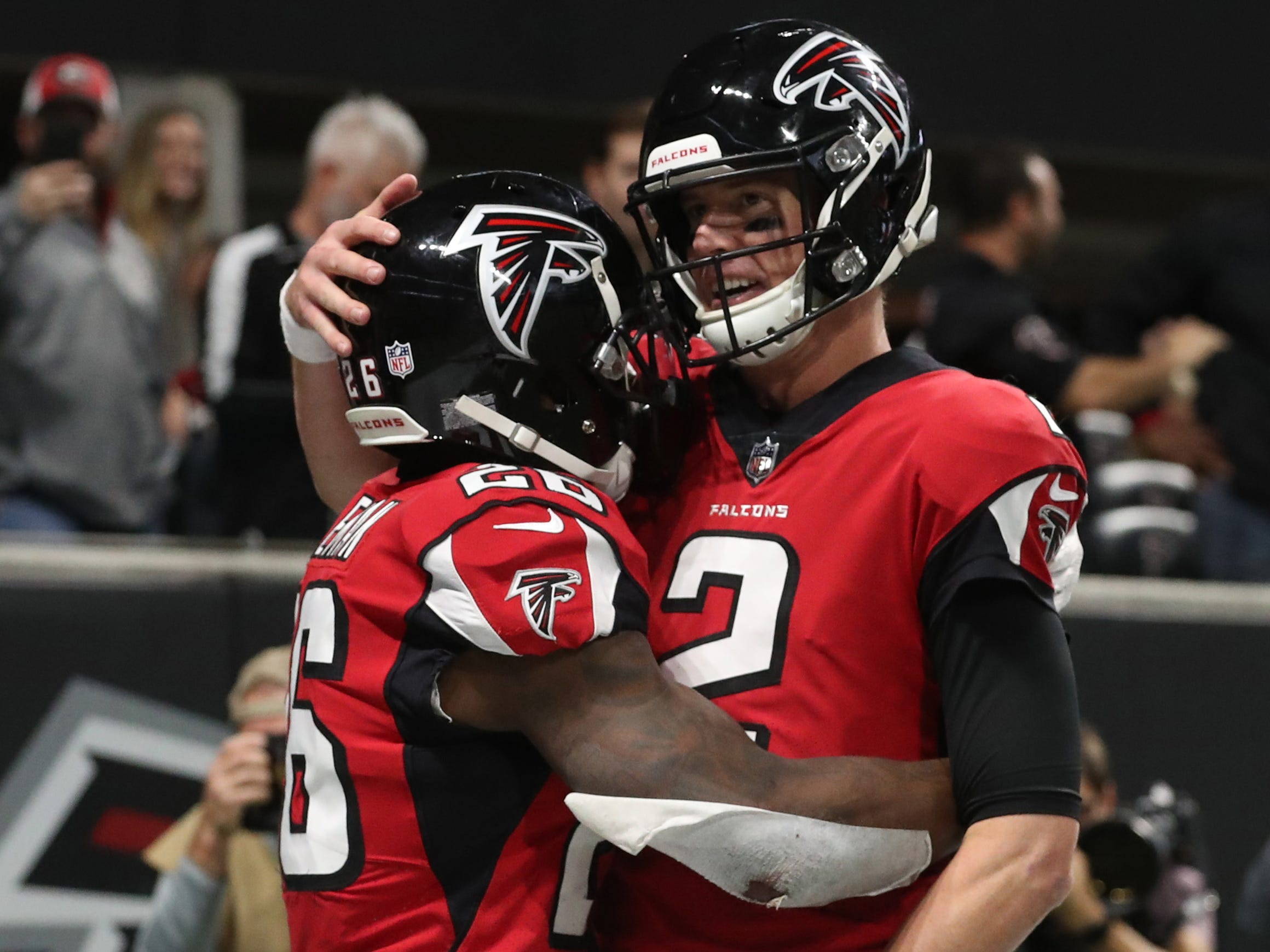 Dec 16, 2018; Atlanta, GA, USA; Atlanta Falcons running back Tevin Coleman (26) celebrates with quarterback Matt Ryan (2) after scoring a touchdown in the third quarter against the Arizona Cardinals at Mercedes-Benz Stadium.