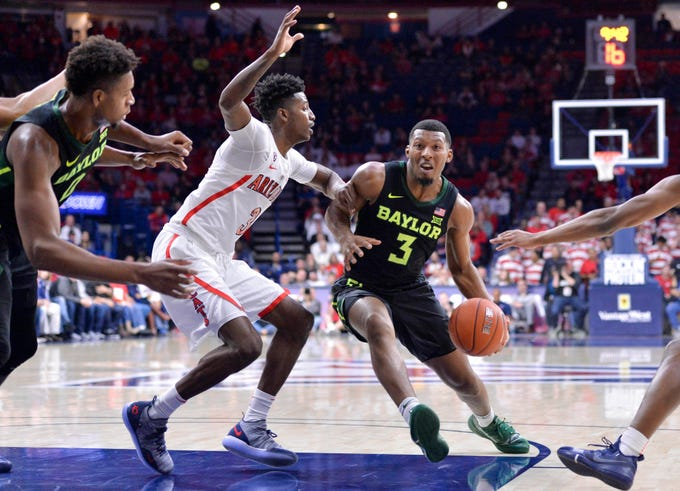 Dec 15, 2018; Tucson, AZ, USA; Baylor Bears guard King McClure (3) drives to the basket as Arizona Wildcats guard Dylan Smith (3) defends during the first half at McKale Center.