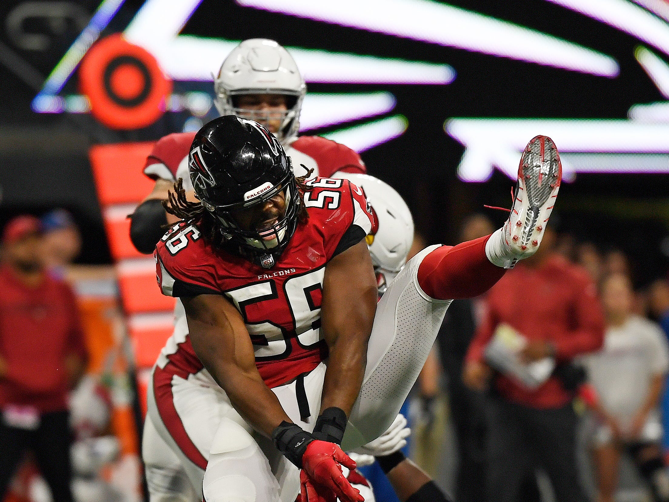Atlanta Falcons defensive end Steven Means (56) celebrates a sack during the second half of an NFL football game Arizona Cardinals, Sunday, Dec. 16, 2018, in Atlanta.