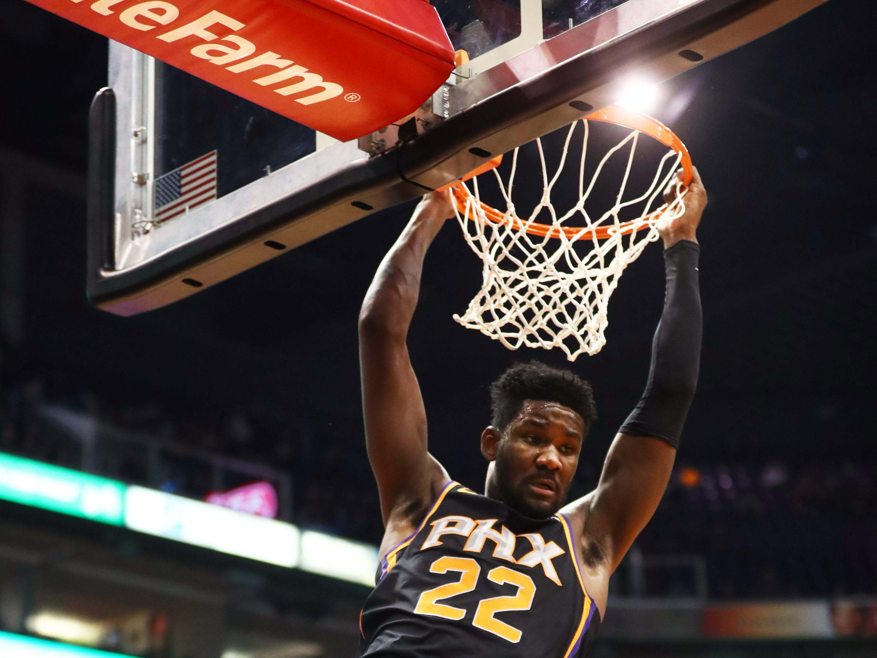 Dec 15, 2018; Phoenix, AZ, USA; Phoenix Suns center Deandre Ayton (22) slam dunks the ball over Minnesota Timberwolves center Gorgui Dieng in the first half at Talking Stick Resort Arena. Mandatory Credit: Mark J. Rebilas-USA TODAY Sports