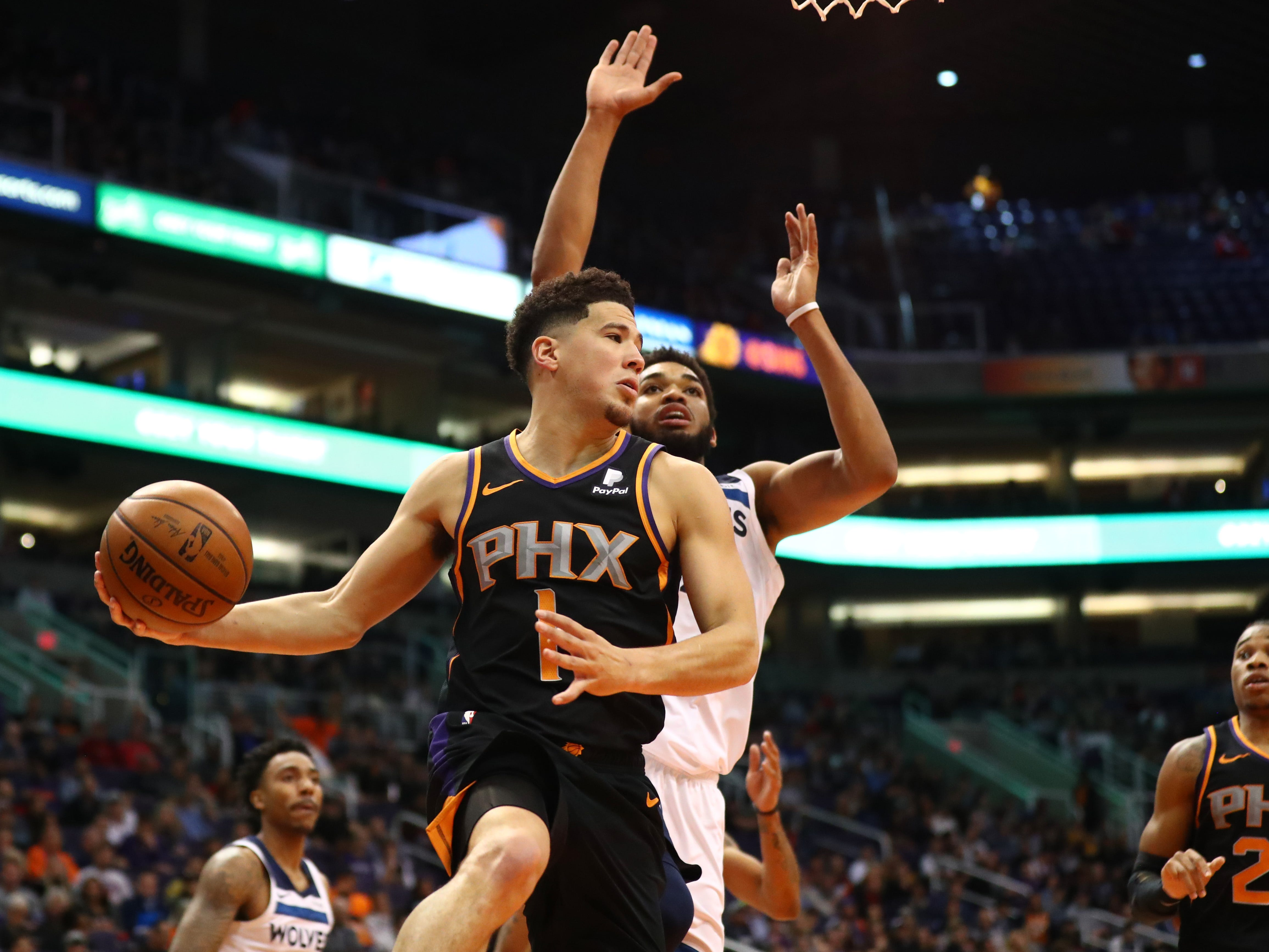 Dec 15, 2018; Phoenix, AZ, USA; Phoenix Suns guard Devin Booker passes the ball in the first half against the Minnesota Timberwolves at Talking Stick Resort Arena. Mandatory Credit: Mark J. Rebilas-USA TODAY Sports
