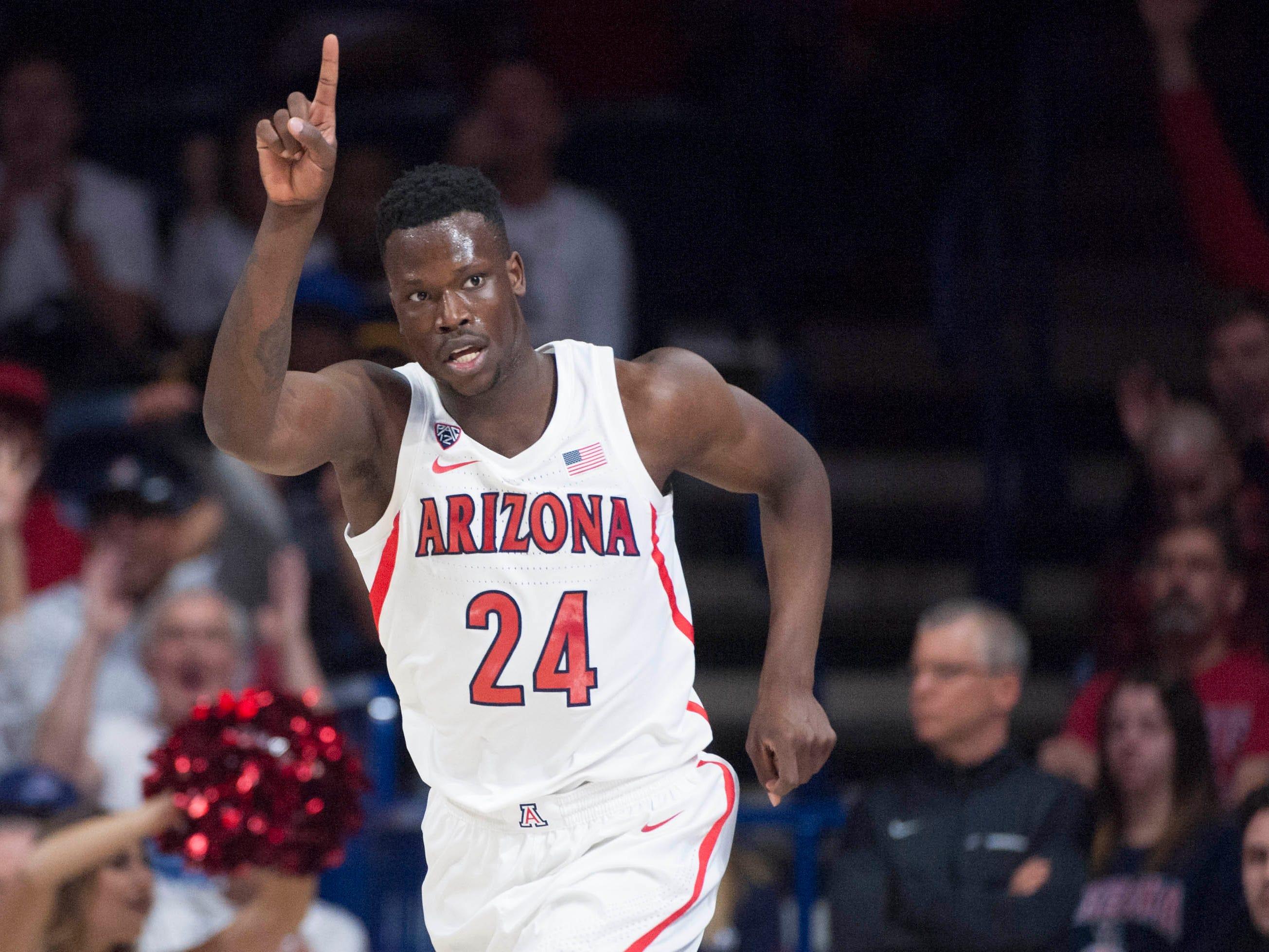Dec 15, 2018; Tucson, AZ, USA; Arizona Wildcats guard Emmanuel Akot (24) celebrates after scoring against the Baylor Bears during the first half at McKale Center.