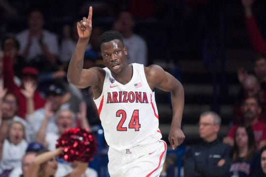 Dec 15, 2018; Tucson, AZ, USA; Arizona Wildcats guard Emmanuel Akot (24) celebrates after scoring against the Baylor Bears during the first half at McKale Center.