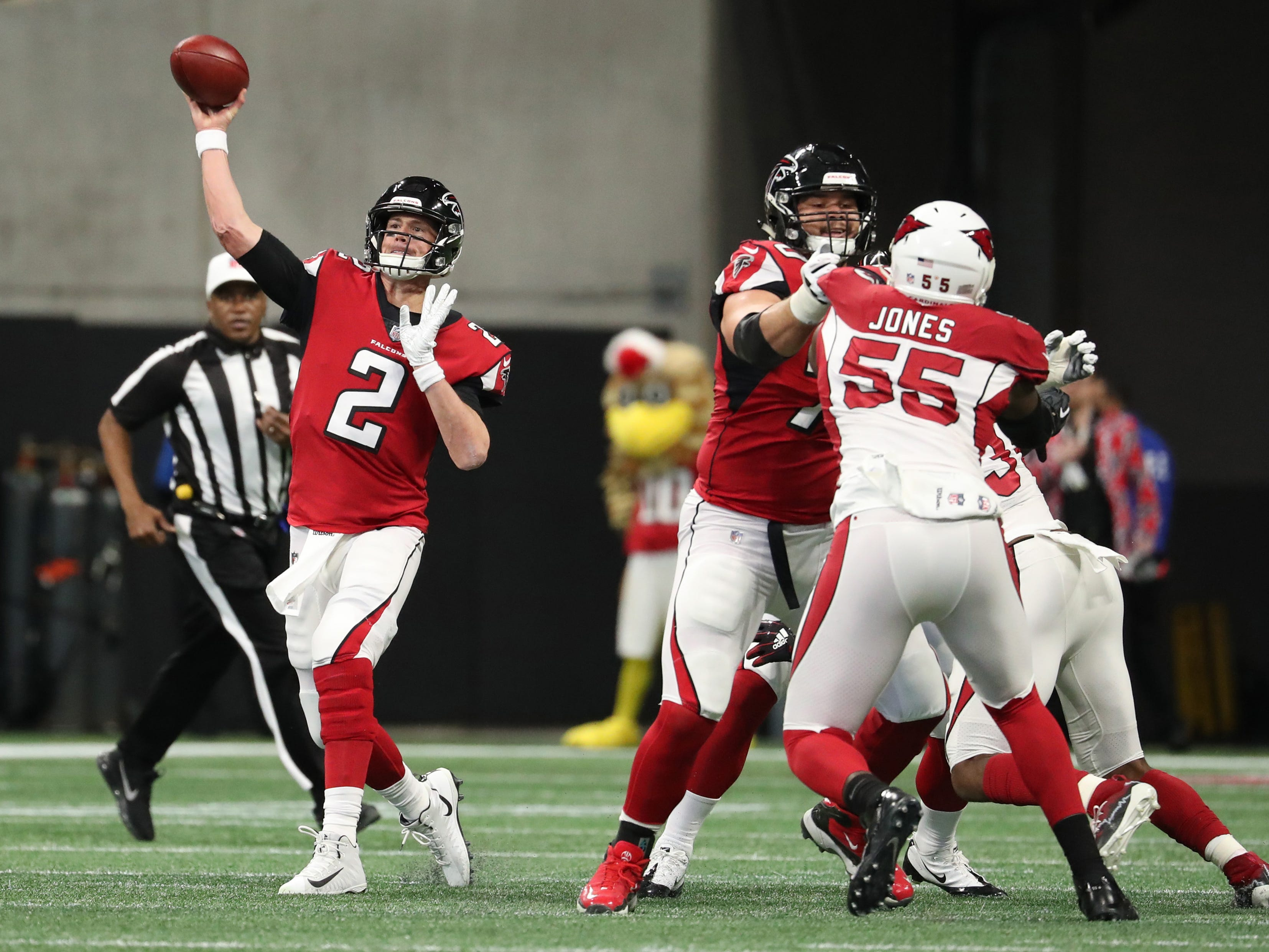 Dec 16, 2018; Atlanta, GA, USA; Atlanta Falcons quarterback Matt Ryan (2) attempts a pass as offensive tackle Jake Matthews (70) blocks Arizona Cardinals defensive end Chandler Jones (55) in the first quarter at Mercedes-Benz Stadium.