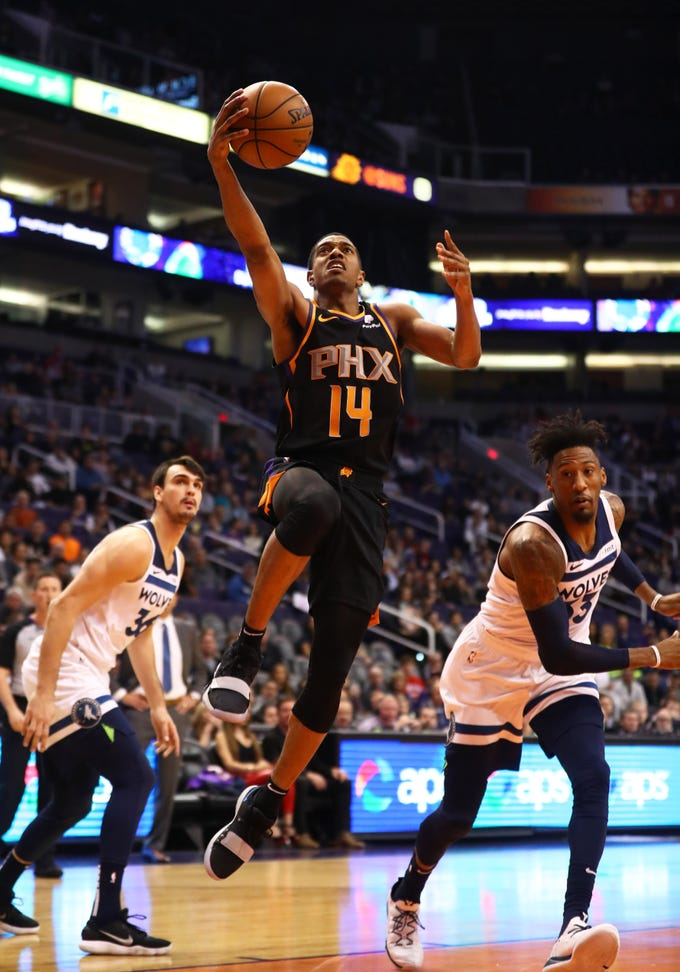 Dec 15, 2018; Phoenix, AZ, USA; Phoenix Suns guard De'Anthony Melton (14) drives to the basket in the first half against the Minnesota Timberwolves at Talking Stick Resort Arena. Mandatory Credit: Mark J. Rebilas-USA TODAY Sports