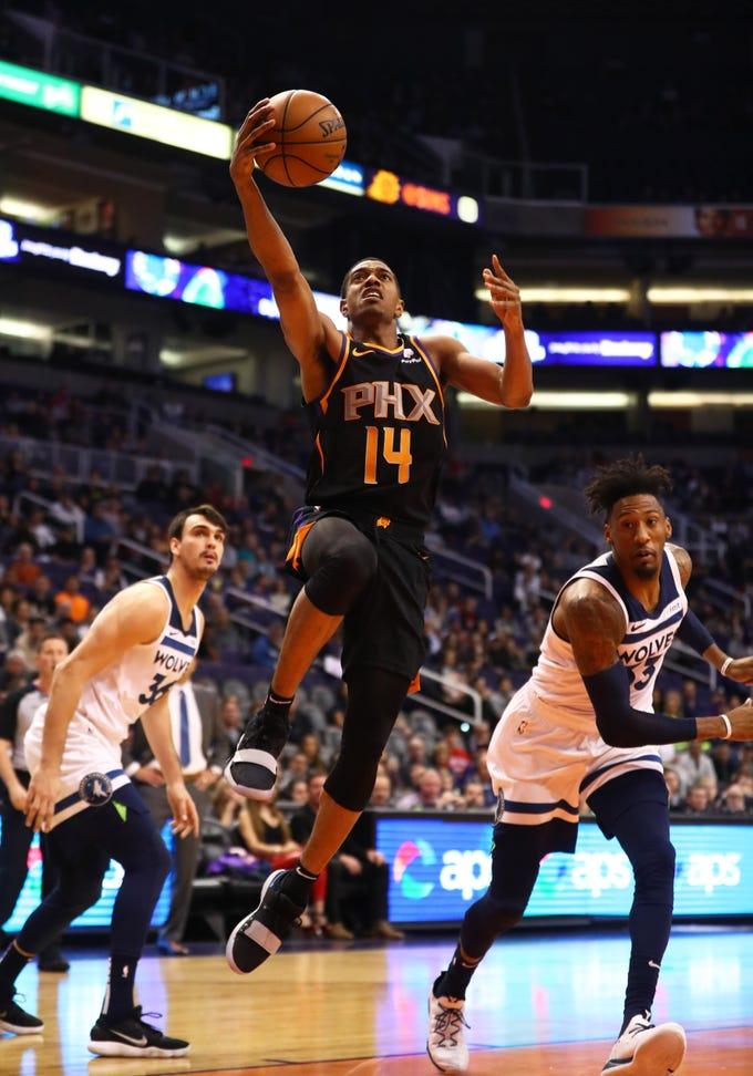 Dec 15, 2018; Phoenix, AZ, USA; Phoenix Suns guard De'Anthony Melton (14) drives to the basket in the first half against the Minnesota Timberwolves at Talking Stick Resort Arena. Mandatory Credit: Mark J. Rebilas-USA TODAY Sports