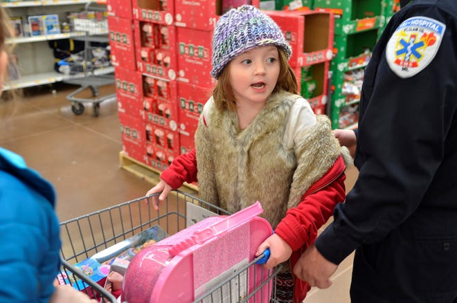 Khloe Davidson, 5, participated in a Shop with a Hero event organized by Tri-Hospital EMS on Sunday, December 16, 2018, in Fort Gratiot, Michigan.
