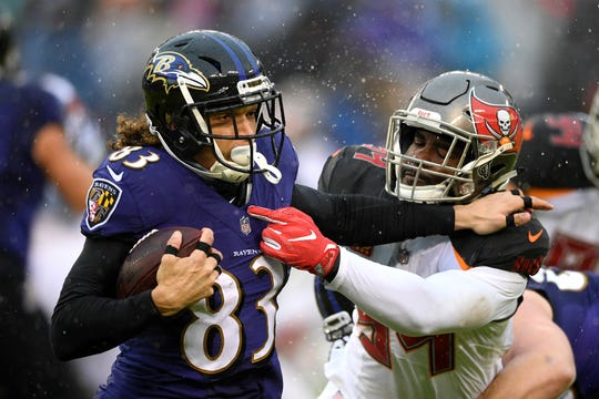 Baltimore Ravens wide receiver Willie Snead, left, rushes against Tampa Bay Buccaneers outside linebacker Lavonte David in the first half of an NFL football game, Sunday, Dec. 16, 2018, in Baltimore. (AP Photo/Nick Wass)