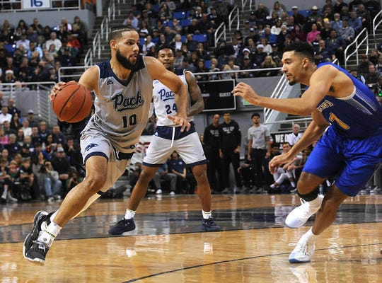 Nevada's Caleb Martin drives against South Dakota State on Saturday night. He finished with 20 points and five assists.