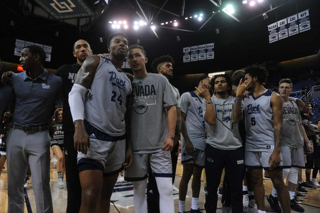 Nevada coaches and players are shown following the Wolf Pack's win over South Dakota State.
