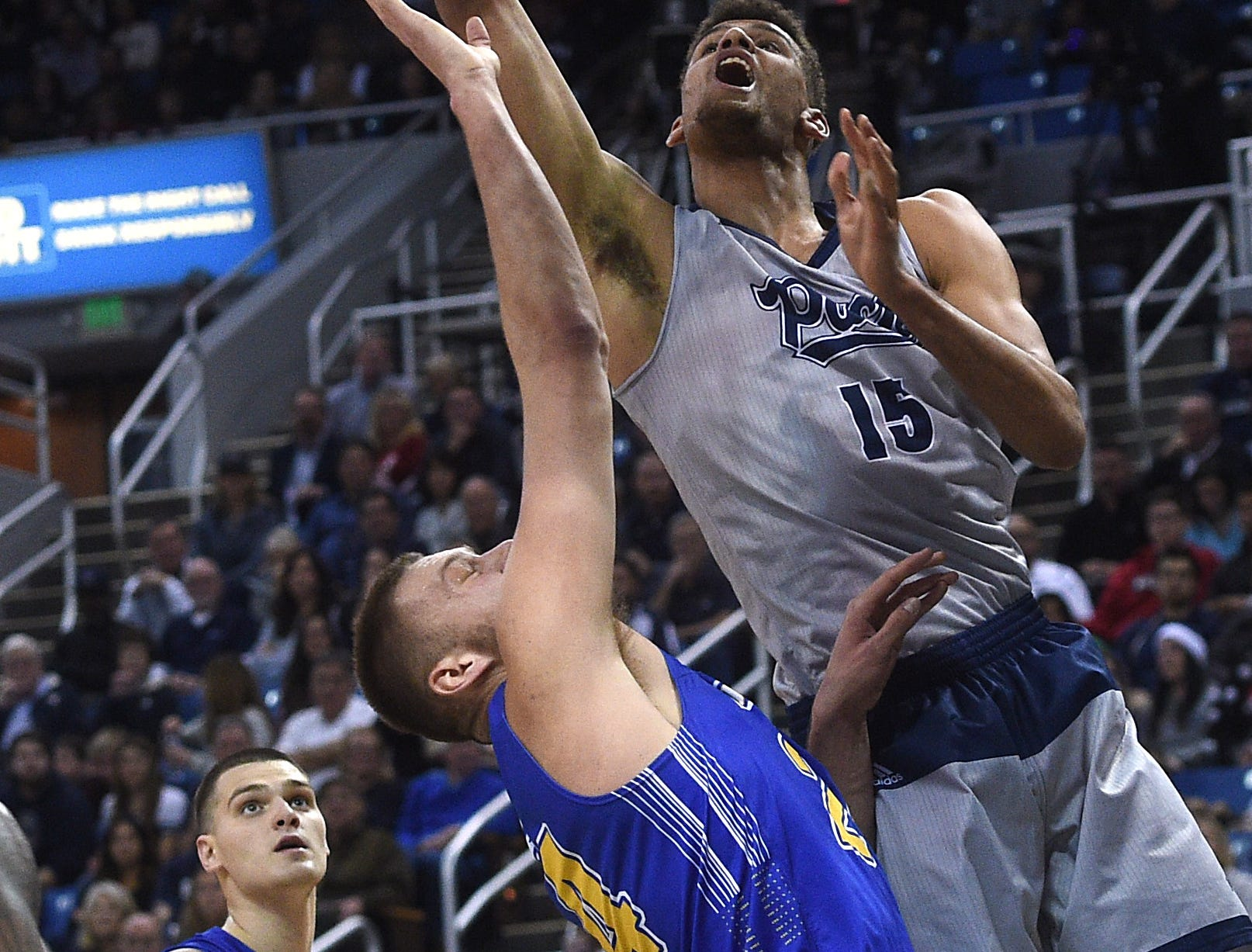 Nevada's Trey Porter (15) drives to the basket while taking on South Dakota State during their basketball game at Lawlor Events Center in Reno on Dec. 15, 2018.