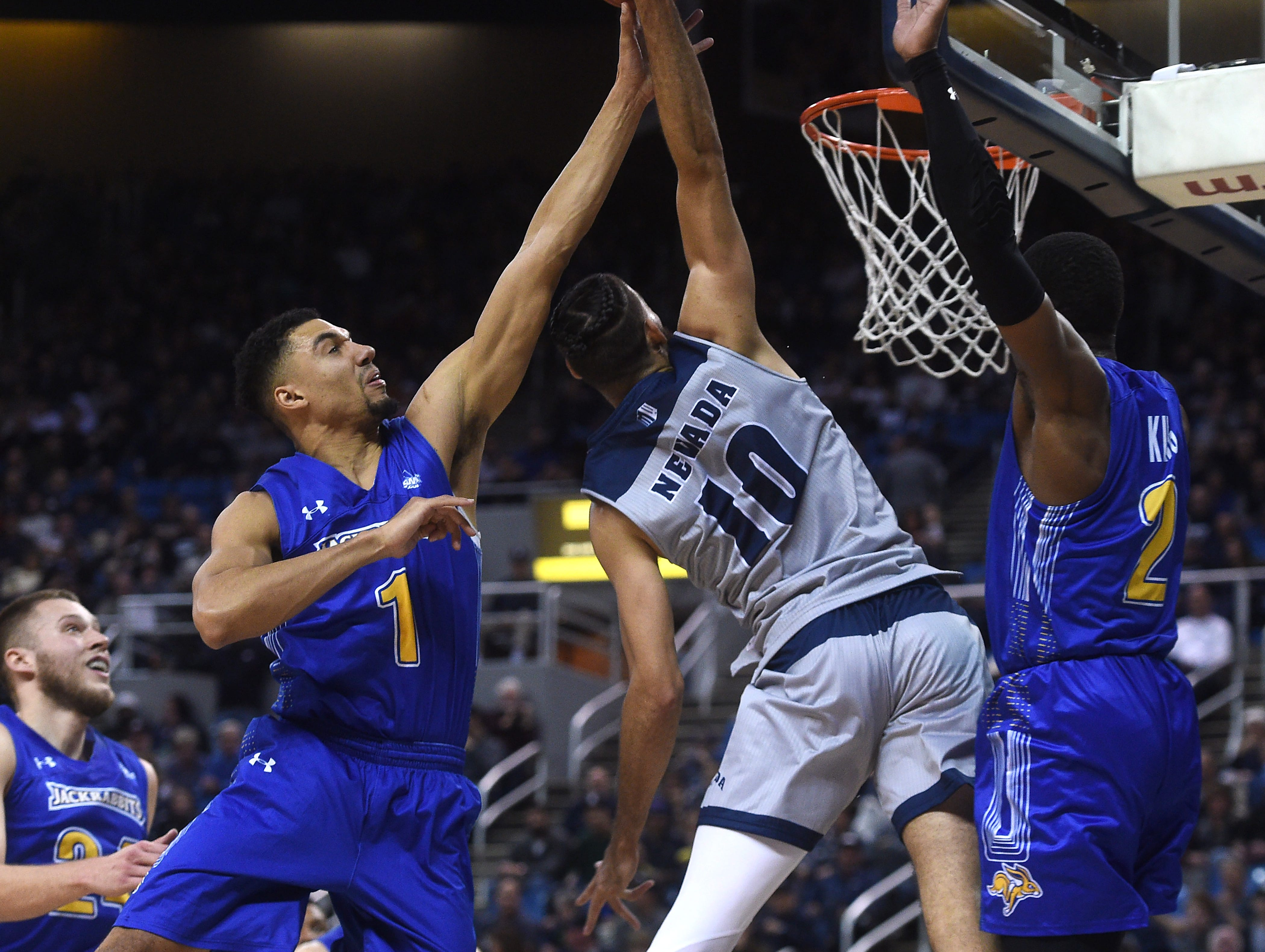 Nevada's Caleb Martin (10) goes in for a dunk while taking on South Dakota State during their basketball game at Lawlor Events Center in Reno on Dec. 15, 2018.