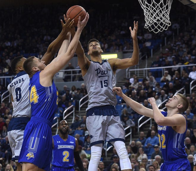 Nevada's Trey Porter (15) grabs a rebound against South Dakota State on Saturday night at Lawlor Events Center.