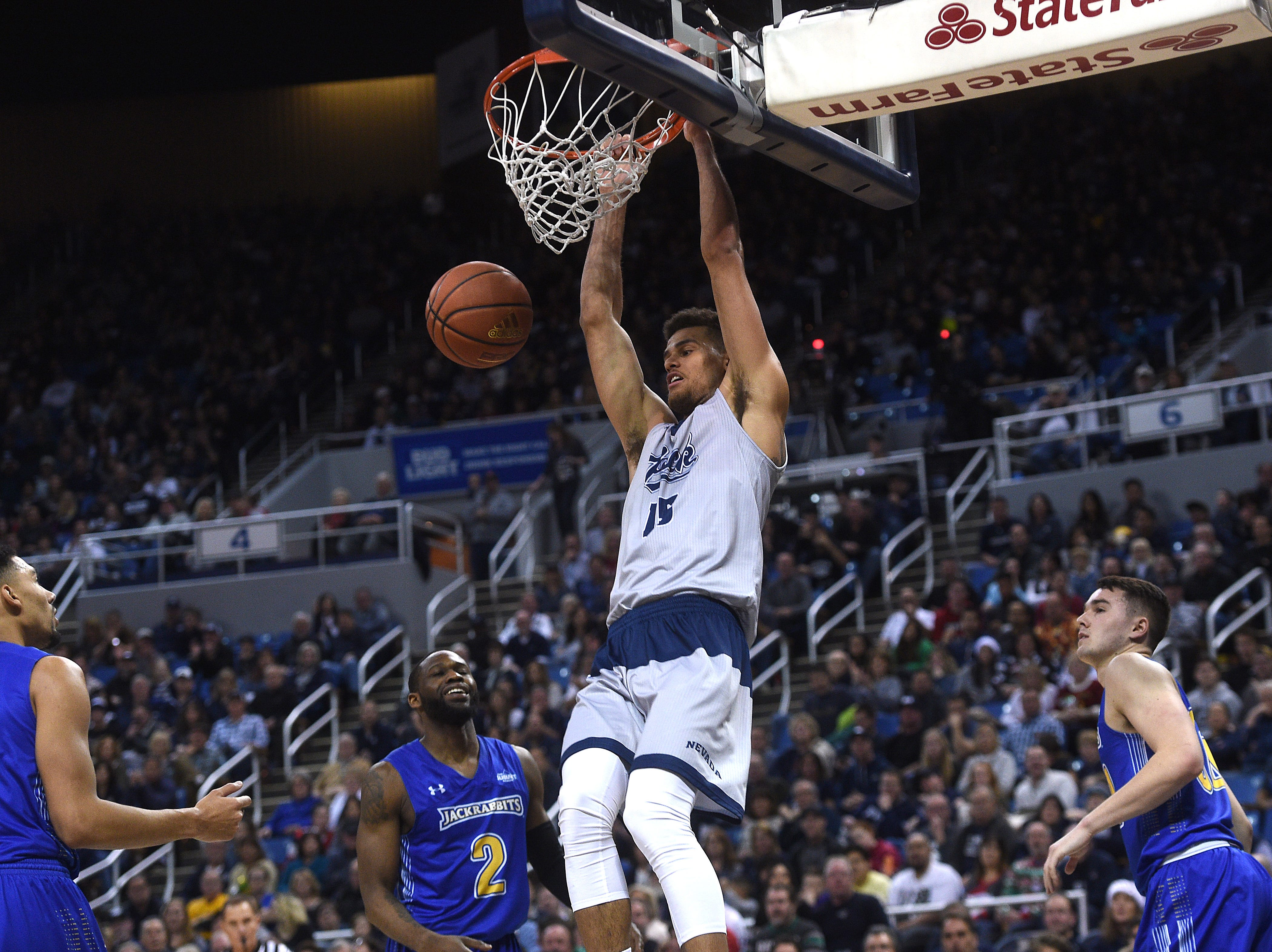 Nevada's Trey Porter (15) dunks while taking on South Dakota State during their basketball game at Lawlor Events Center in Reno on Dec. 15, 2018.