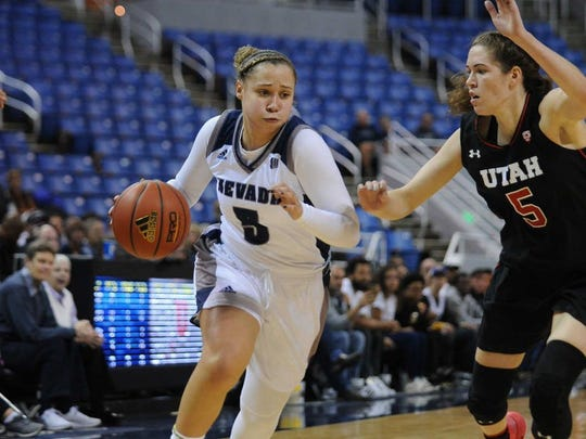 Nevada's Mikayla Christian, left, drives against Utah's Megan Huff in November.