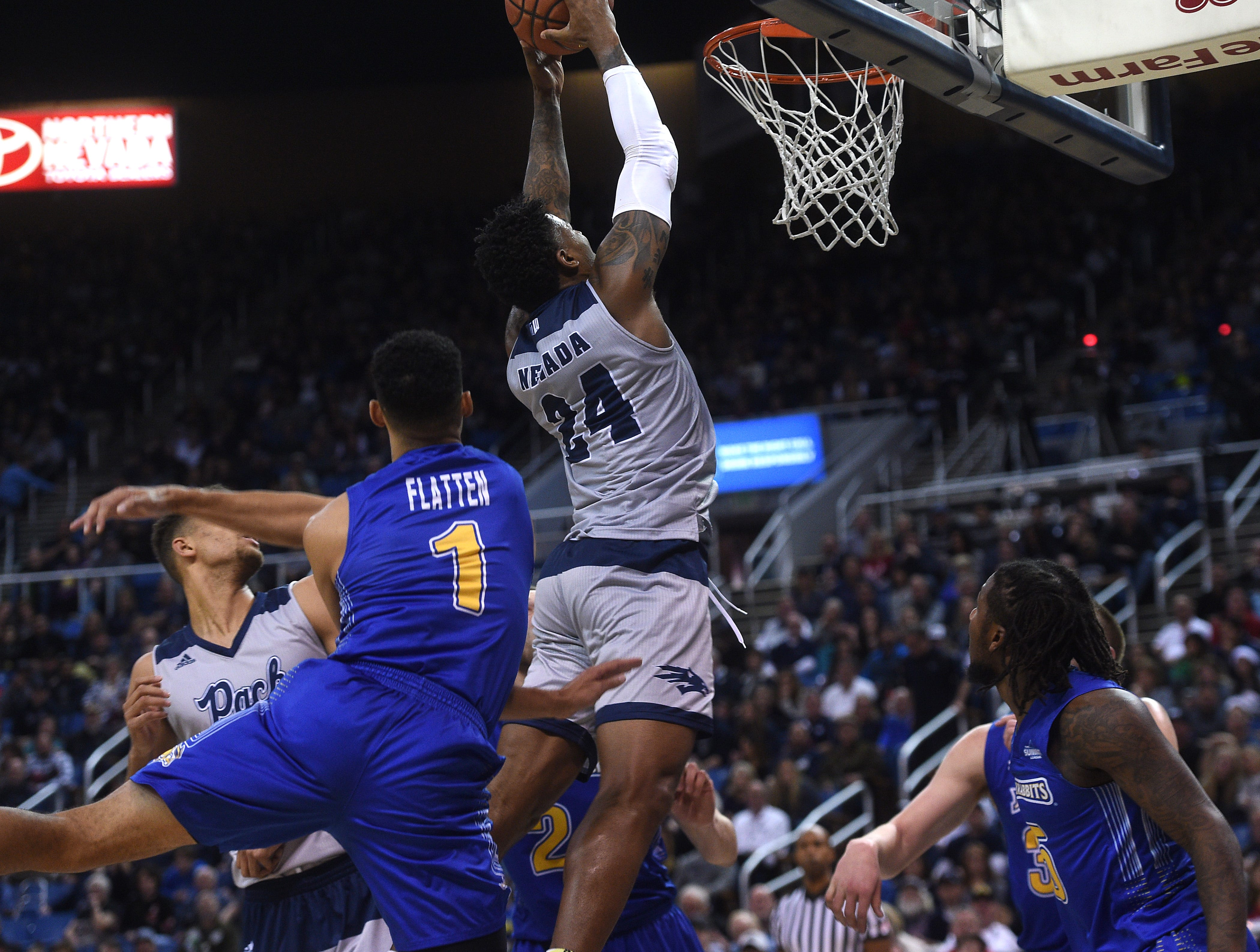 Nevada's Jordan Caroline dunks while taking on South Dakota State during their basketball game at Lawlor Events Center in Reno on Dec. 15, 2018.