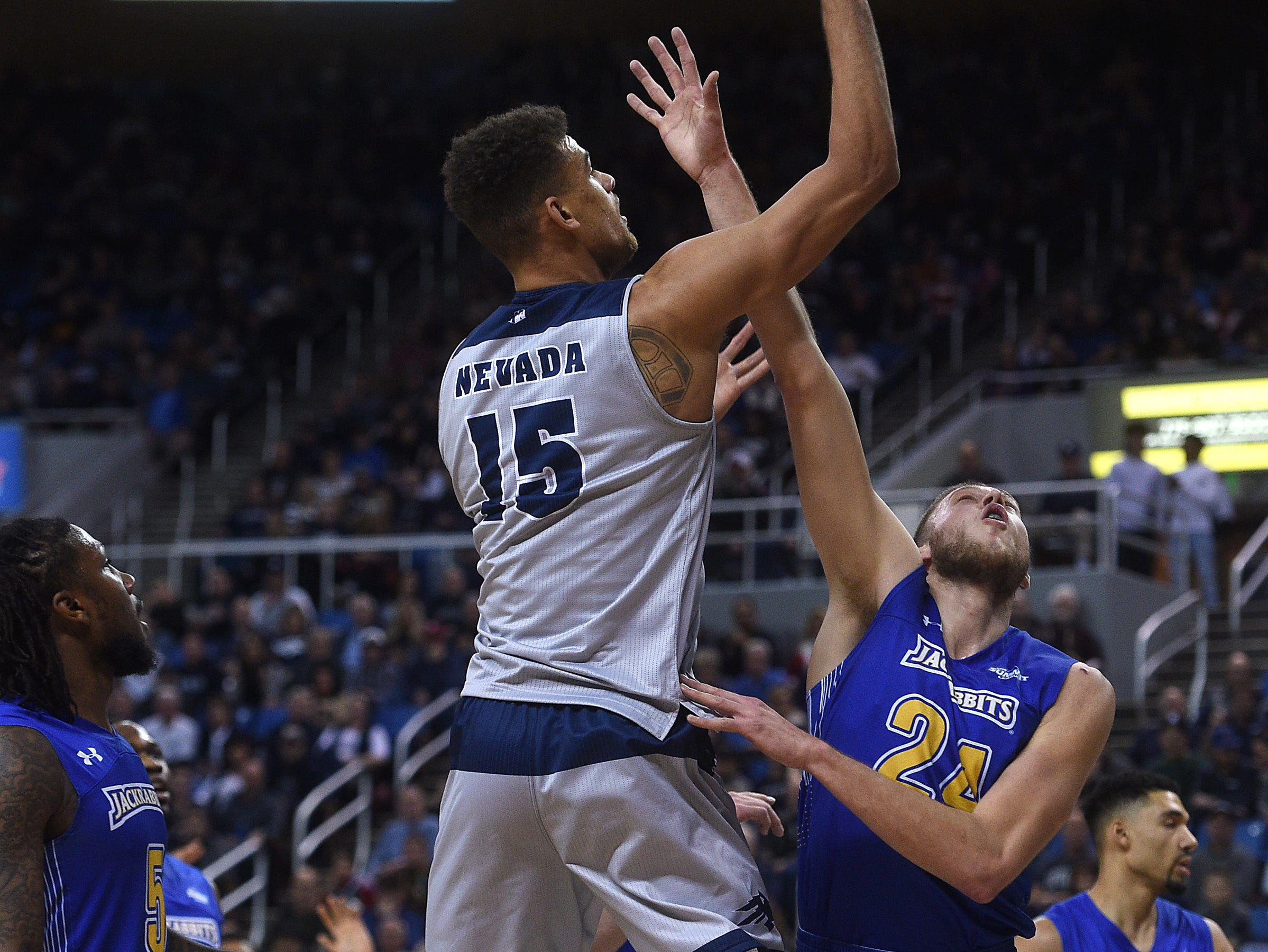 Nevada's Trey Porter (15) shoots while taking on South Dakota State during their basketball game at Lawlor Events Center in Reno on Dec. 15, 2018.