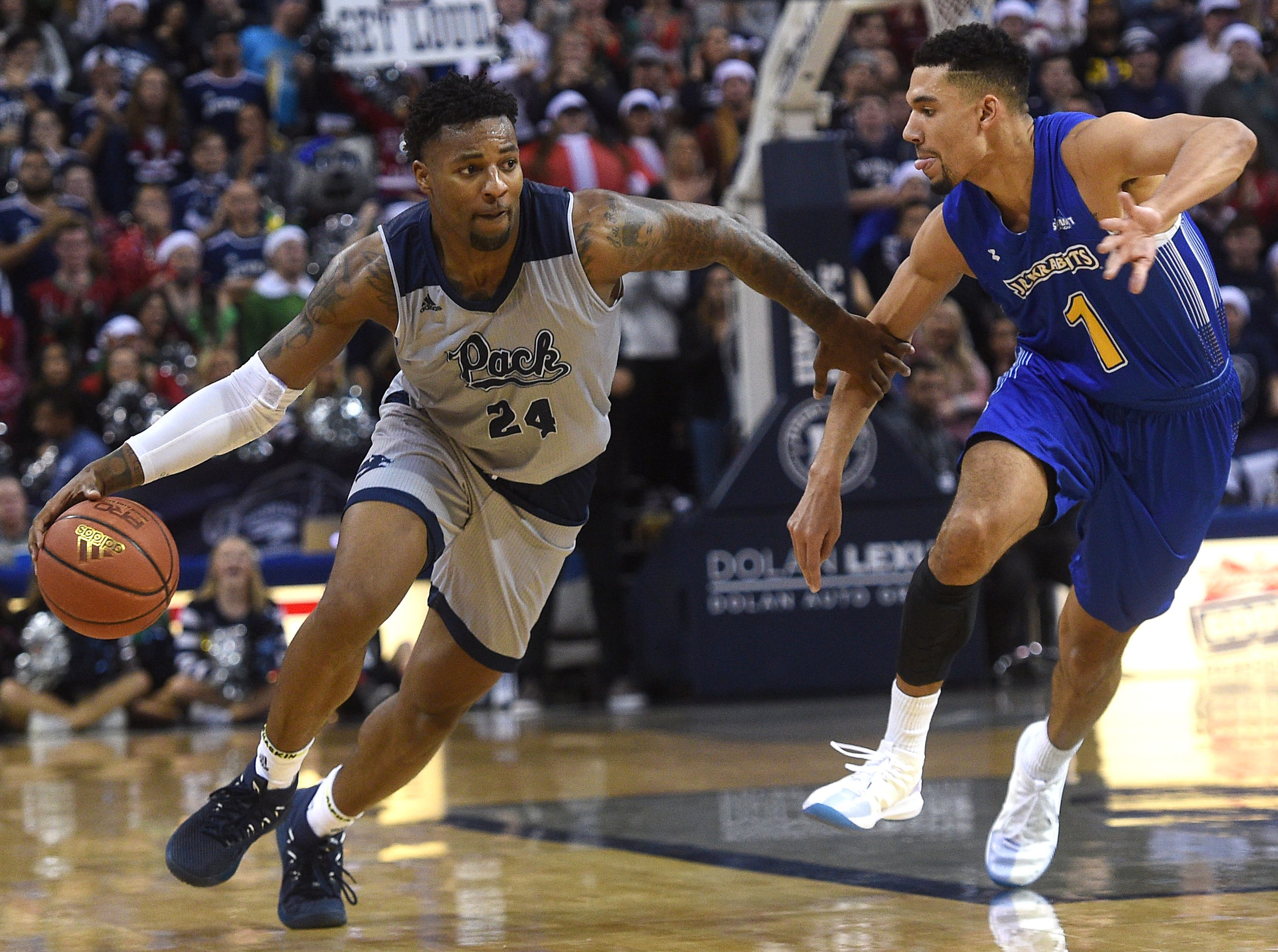 Nevada's Jordan Caroline brings the ball up court while taking on South Dakota State during their basketball game at Lawlor Events Center in Reno on Dec. 15, 2018.